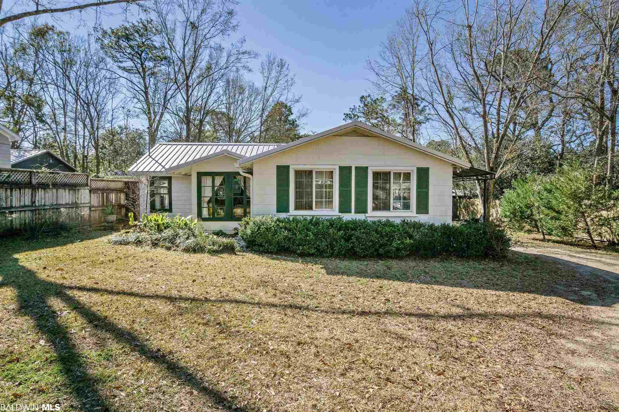 Step inside the most unique and quaint cottage in town and take a walk back to an earlier time in Fairhope.  Even though it is an older home it boasts new roof, recently replaced heat and air, tankless water heater, new sewage pipes to the street, new gutters and new refrigerator. The high ceilings show open beams through out.  Lots of privacy and larger lot give lots of possibilities.  Great location  with in walking distance to shopping, and restaurants.  Close to everything yet this lot offers privacy in a peaceful setting.   Seller motivated and NO HOA.