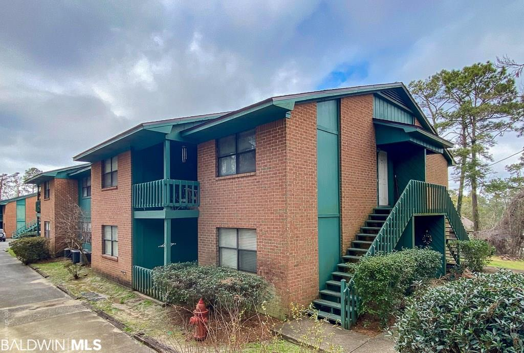 Centrally located condo in the heart of Daphne! Close to the shopping centers and I10 this property features a full size washer/dryer hookup, NEW AC unit in 2019 (14 SEER Goodman), NEW carpet in 2018 and a fully equipped kitchen including refrigerator and microwave. This unit is very private and has a great deck over looking the pool. Call today to see it for yourself!