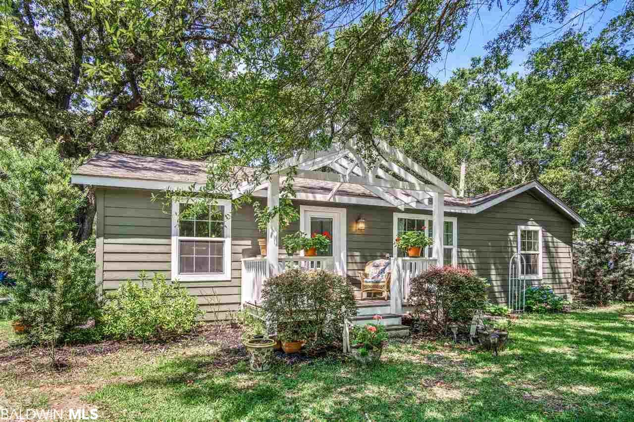 Fabulous Fairhope Find!  This precious cottage is a dream and is located in the highly desirable Fruit and Nut District.  This gem underwent a total remodel in 2013. Owner has recently installed a new gas furnace. Kitchen has granite counter tops with a bar, stainless steel appliances, recessed and pendant lights. Large master bedroom with room for a small office, nursery or sitting area. Tile in kitchen and wet areas, hardwood flooring in living room and hall. Deck in the back and a storage building. This property is within walking distance to the historic downtown area of Fairhope.  Gorgeous shaded lot with mature oak trees. You will find lovely boutiques, decadent restaurants and southern Alabama charm. Come today and see what this darling cottage has to offer!