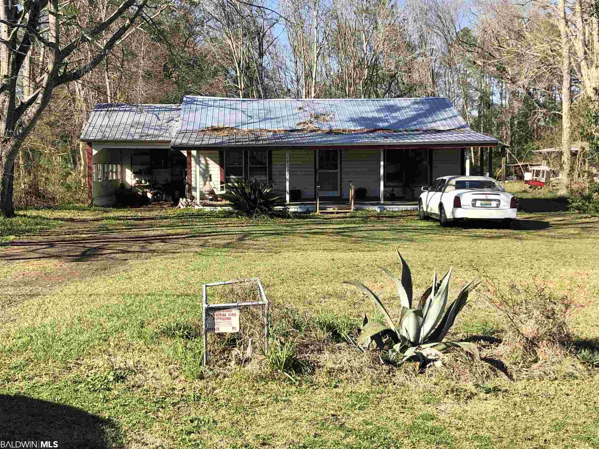 PPIN #'s 072064 and 043277 to convey for a total of 1.92 acres. (Acreage and etc is a combination of both parcels) The house is in need of a lot of work, unless your handy this would probably be a tear down situation. The location is great, right on Highway 90, within eyesight to the Dollar Store.