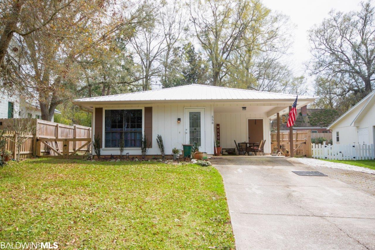 Quaint cottage with so much potential. Excellent location within walking distance to downtown Fairhope shopping and restaurants and a short bike ride to the bay. Only one block from the Performing Arts Pavilion and one block from public tennis courts & walking/jogging track. New metal roof in 2020. Not included in the 1261 square feet, is an additional 165 square feet proposed for master closet, laundry room relocation and kitchen renovation. Open family and dining rooms with lots of natural light. Tile flooring and shutters throughout the home. Fenced back yard with shed and an open single carport with storage room. Make this your home before the 2021 Arts and Crafts Festival! All information provided is deemed reliable but not guaranteed. Buyer or buyer's agent to verify all information.