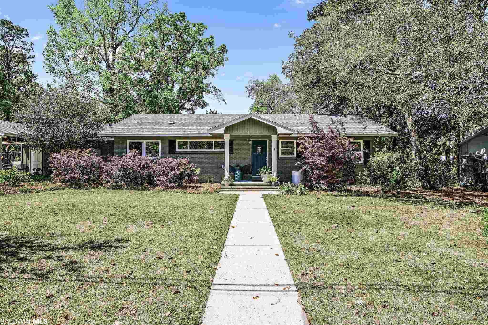"""Looking for Fairhope living? This ranch in the """"Old Fairhope"""" area of town is one you don't want to miss. Being on a cul de sac and near the Jasmine park, this is one of the most convenient locations in town! Brick exterior and a new bronze certified roof anchor this 3 bedroom, 2 bath home. Enjoy a remodeled kitchen by Mike Kerr Construction that is equipped with gas stove, gorgeous farmhouse pedal operated sink and original split brick floors. The large living room and bedrooms are adorned with original hardwood floors. Dining room offers panoramic views of the beautiful, lush backyard. There is an additional room currently used as an office, which could hold many uses. Schedule a visit with your favorite agent today!  Open House Saturday 4/3 1-5:00"""