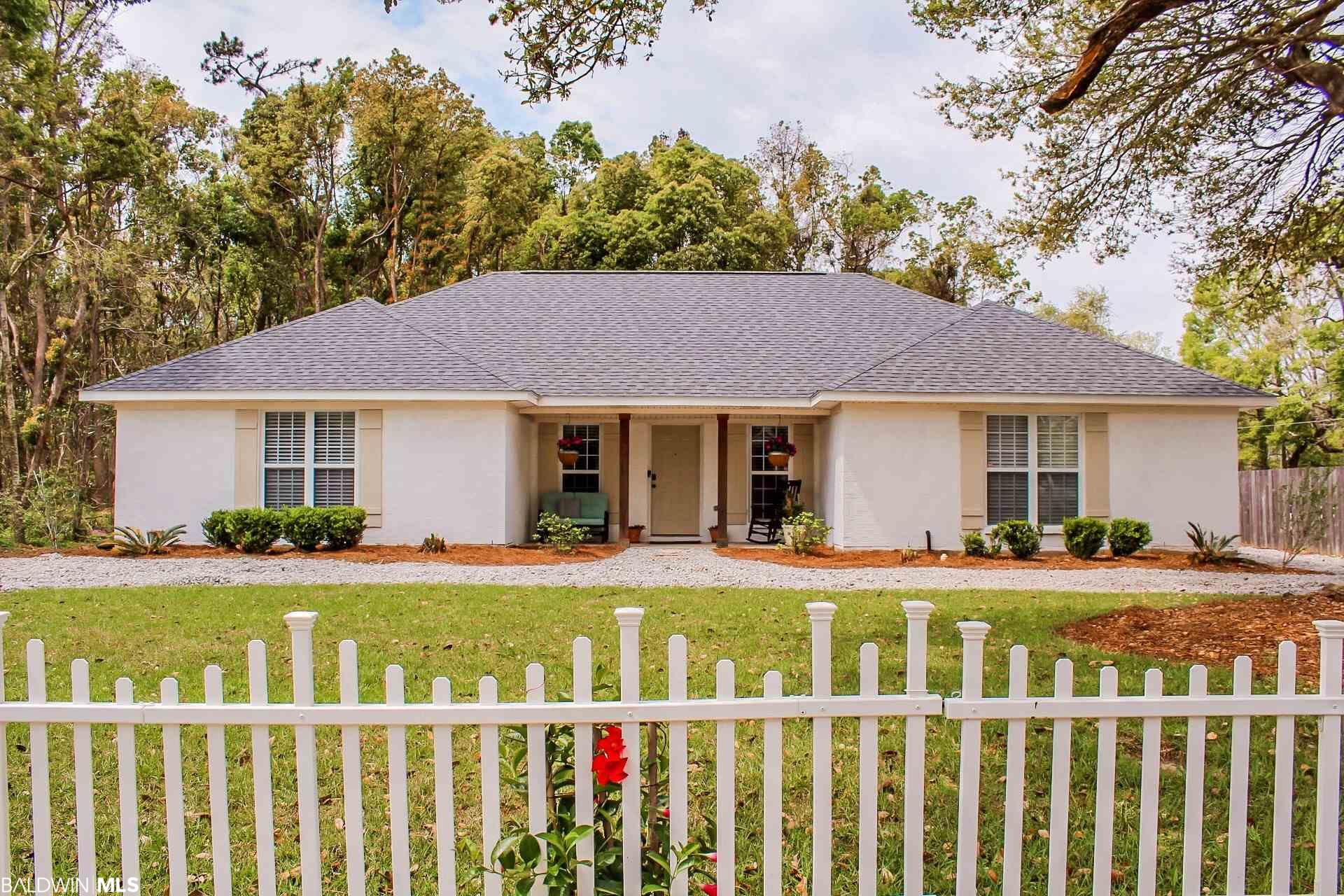 COASTAL meets COTTAGE living in Fairhope.  Close to the hospital, tennis courts & downtown. Fenced corner lot and private green space currently surrounds this painted brick home.  Bronze certified NEW ROOF and CIRCULAR drive is one of the many updates. 12x12 outside deck with canvas sail cloth canopy for entertaining & fire pit. Shed is 10x10 and has a lean to for bikes. Double french doors from patio to morning room.  Open concept living with all hard surface floors in the main areas.  New carpet in the bedrooms. Great room has soaring ceiling  with a wood burning FIREPLACE. MARBLE countertops, island and back splash. Coffee Bar & pantry. Drop in sink with sunny kitchen window above. Refrigerator conveys. SPLIT bedroom Plan. Master en suite has large soaking tub & sep. shower. Gigantic master closet.  Bedroom#2 & #3 have jack & jill baths with an additional bath area with private sink for guests.   Sliding BARN DOORS and large closets in each room.  Newly landscaped exterior with HIGH END LIMESTONE GRAVEL and NEW SOD AND STRAW!! BRING YOUR GOLF CART AND RIDE TO FIRST FRIDAY BEFORE THIS ONE IS SOLD!