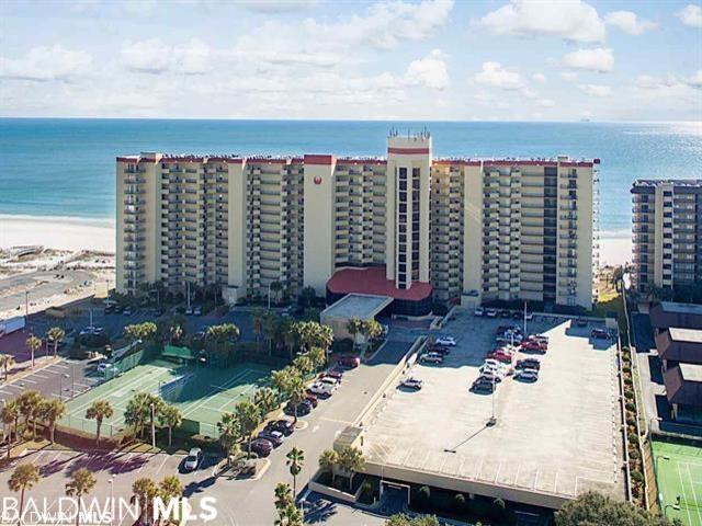 Vacant and ready to show. Beautiful three bedroom two bath condominium overlooking the sugar white sands and emerald green waters of the Gulf of Mexico. Upgraded unit has nice kitchen cabinets, granite countertops and many extras. Phoenix V has wonderful resort like amenities.