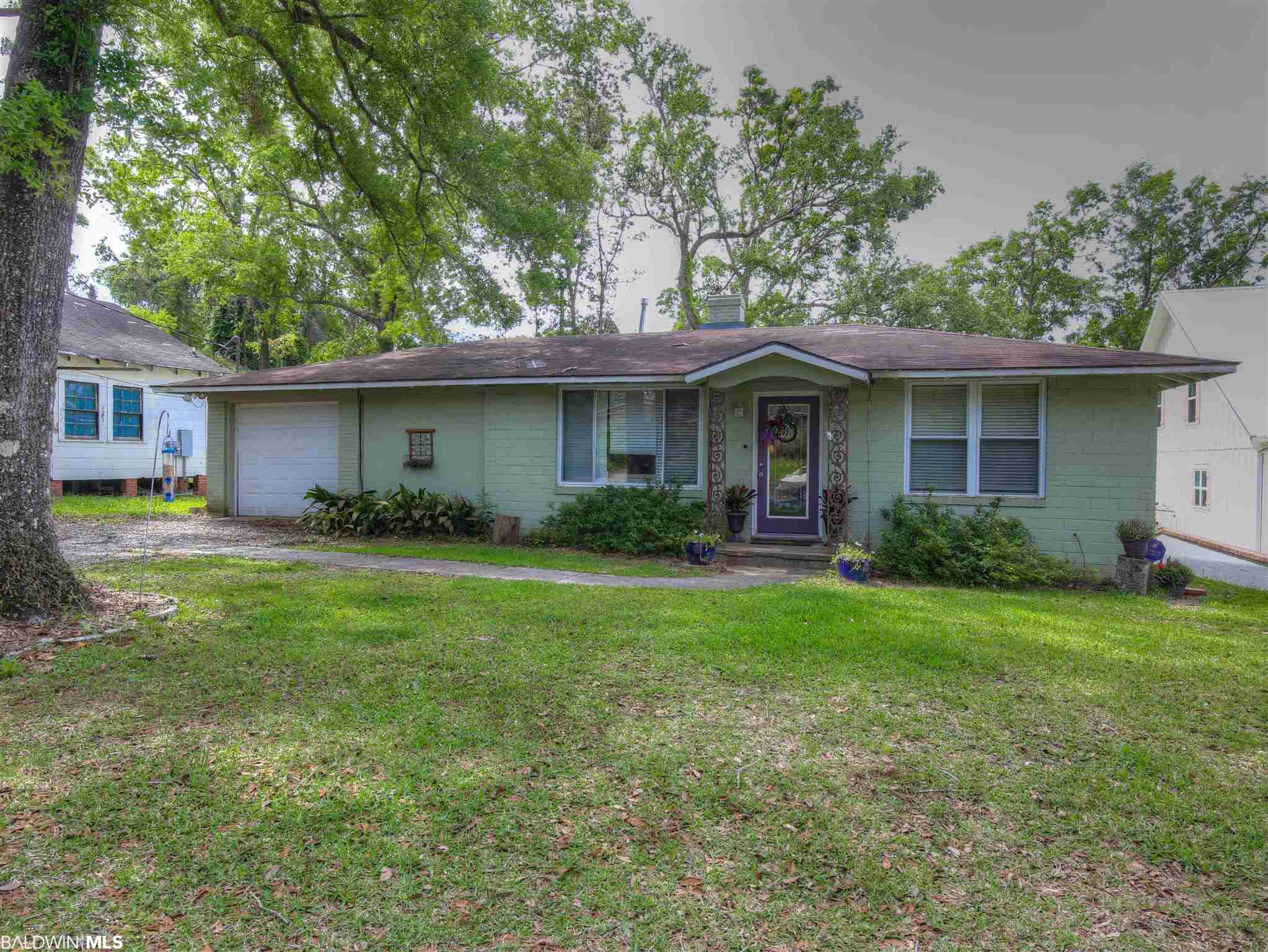 """This quaint cottage is merely a short stroll (less than 3 blocks) away from the sunsets of Mobile Bay. Enjoy your days having fun on the Bay or shopping/dining in downtown Fairhope. This cozy bungalow could be completely renovated or tear it down and build the home of your dreams on beautiful Pier Avenue.  Utilities are already in place. Home is being sold """"AS-IS""""."""