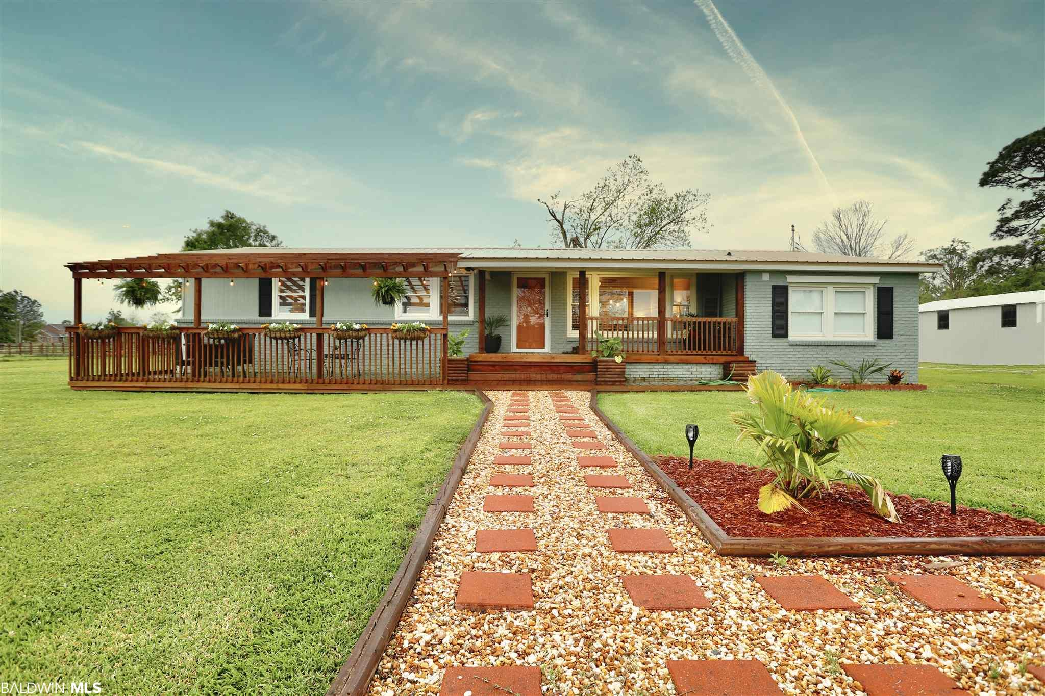 Remodeled 4 Bedroom, 3 Bath, Beautiful Home sitting on 1.4 Acres!  The upgrades built into this home are absolutely stunning.  Every small detail is put in the right place.  The kitchen is the perfect place to entertain which opens up into a spacious living room to relax.  The master bathroom looks like you walking right into a Spa with a free standing soaking tub, a stone and tile shower and double vanities!  You  can relax on your front porch or out your back door into your sitting area while enjoying a cocktail and grilling tonight's dinner.  The property comes with a 24' X 40' Metal workshop/garage that is perfect for storage and the perfect shop work out of!  You are away from the hustle of the city but close enough to I-10 to get anywhere fast!