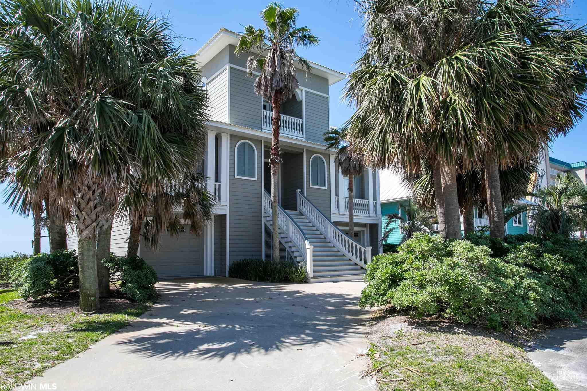 RARE OPPORTUNITY FOR PRIVATE BEACHFRONT LIVING IN THE HEART OF PERDIDO KEY! Parasol is a secure, gated gulf-front community that encompasses 900'+ of sugar white sand beaches and just a short walk to Johnson Beach and the National Seashore! This coastal charmer sits on 75' of beachfront and boasts 5 bedrooms, 5.5 baths on 3 floors with a custom elevator servicing all levels. The 1,400+ sq.ft. outdoor dining and relaxation areas with deep covered porches allow for maximum privacy and unobstructed gulf-views! The open main living level is perfect for entertaining with views from every room, featuring hardwood floors, 10ft ceilings, and an abundance of natural light! The living room is complete with wet bar, wine cooler, and ice maker! The kitchen exudes elegance with granite countertops, stainless steel appliances, 2 Bosch side by side ovens, dishwasher, Viking 5 burner stove, commercial grade exhaust accentuated by stunning mantle and tumble marbled detailing, Rohl nickel faucets, 8' wide custom pantry, oversized granite island with prep sink, and bar seating which allows guests to join the kitchen experience. Tucked behind the kitchen is a quiet nook perfect for an office! The main level has a secluded 2nd master suite with en-suite bathroom tucked away for extra privacy. The exquisite custom curved staircase leads to a 3rd level living area, 2nd office, master suite and 2 guest suites. Gulf front master suite includes private covered porch, his/hers closets, en-suite bath, steam shower, dual vanities, and luxury spa tub. The 1st Floor family/game room is where all the fun happens after a long day at the beach! Guests and family can enjoy the tv room, kitchenette, large guest bedroom/bath and add'l full bath - leading outside to outdoor covered patio just steps from the sand. Come home to this amazing beach getaway where paradise awaits!