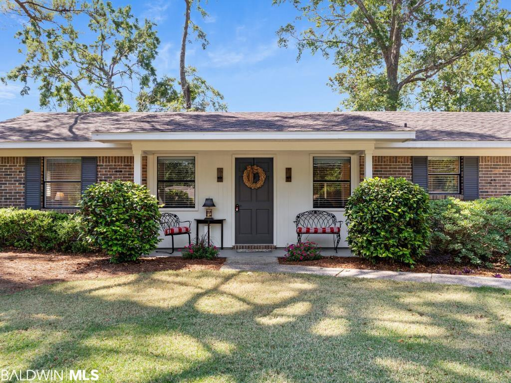 Meticulously remodeled and maintained, this single-level brick ranch cottage is two blocks from Mobile Bay and within walking distance of the pier and downtown. With large windows, hardwood floors, modern updates, and beautiful landscaping, the property provides an inviting, relaxing, easy-living retreat.  The flexible floorplan can be configured to accommodate either 2 or 3 bedrooms. The flexibility continues with oversized closets featuring ELFA adjustable closet systems. The master bathroom is new and features a walk-in glass shower. The kitchen has solid maple cabinetry, granite countertops and a separate beverage bar.  The large, private backyard is fenced with two large patios and water features.  The carport can house two cars which is unique in Paddock Estates.  Improvements made within the last two years include a new fortified-designated roof, a new 16-seer HVAC, new bedroom carpeting, a new second master closet, new LED lighting fixtures, a new front yard (zoysia sod), and restoration of the well-water irrigation system.  House will be sold with all appliances.  Furnishings are also included – three beds, various tables and chairs, 2 TVs, artwork, dishes, glassware, coffee maker, lawn mower, window treatments. All information is deemed accurate, but not guaranteed.  Buyers should verify to their satisfaction all measurements and information.