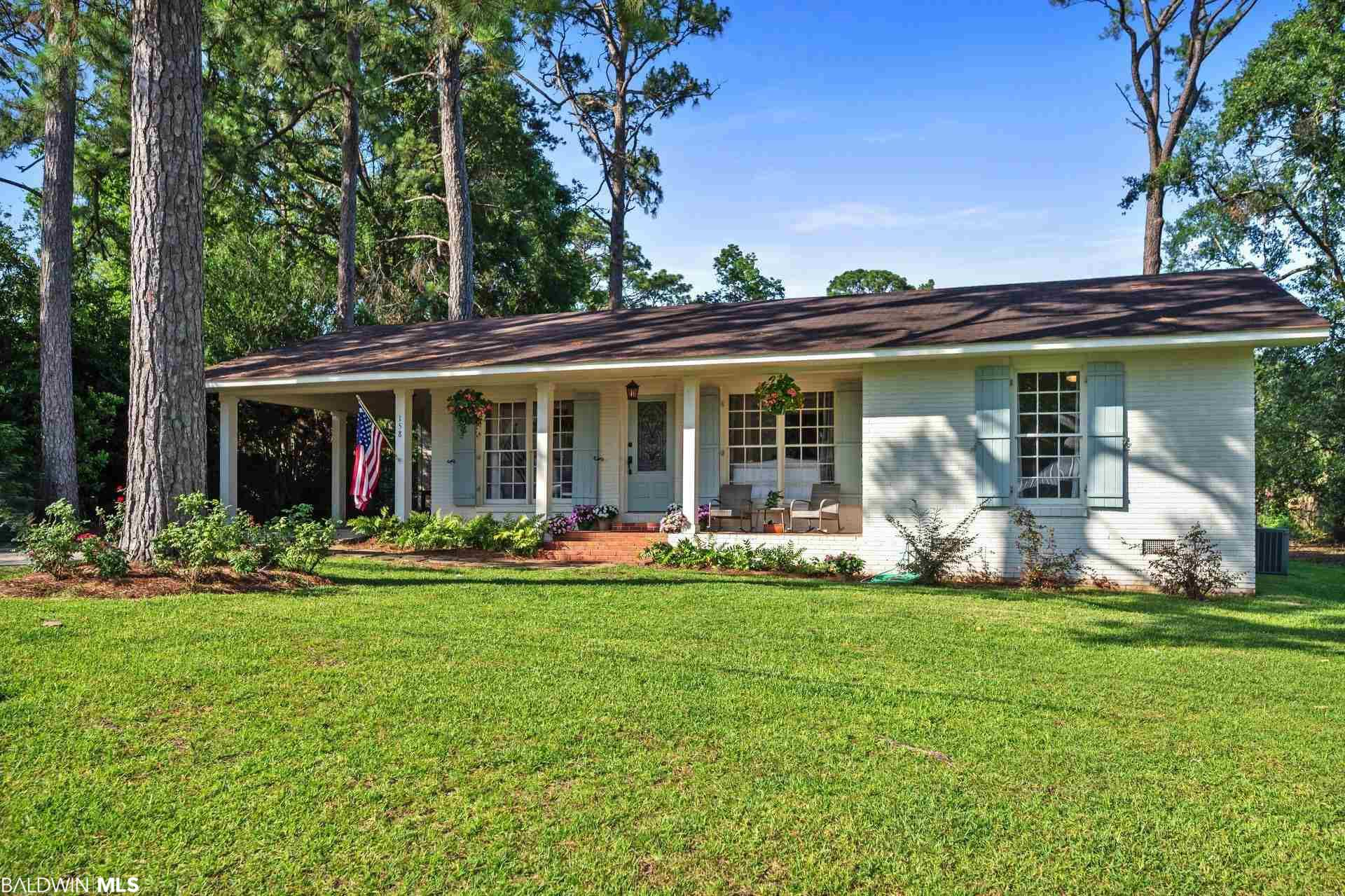 Enjoy the most beautiful sunsets on Mobile Bay just blocks away from this charming cottage.  Walking distance to the town center of historic Fairhope.  This 3 bedroom, 2 bath home has all the character.  Newly updated kitchen with granite counter tops and gas stove.  New paint throughout.   Seller is a licensed real estate agent in Alabama.