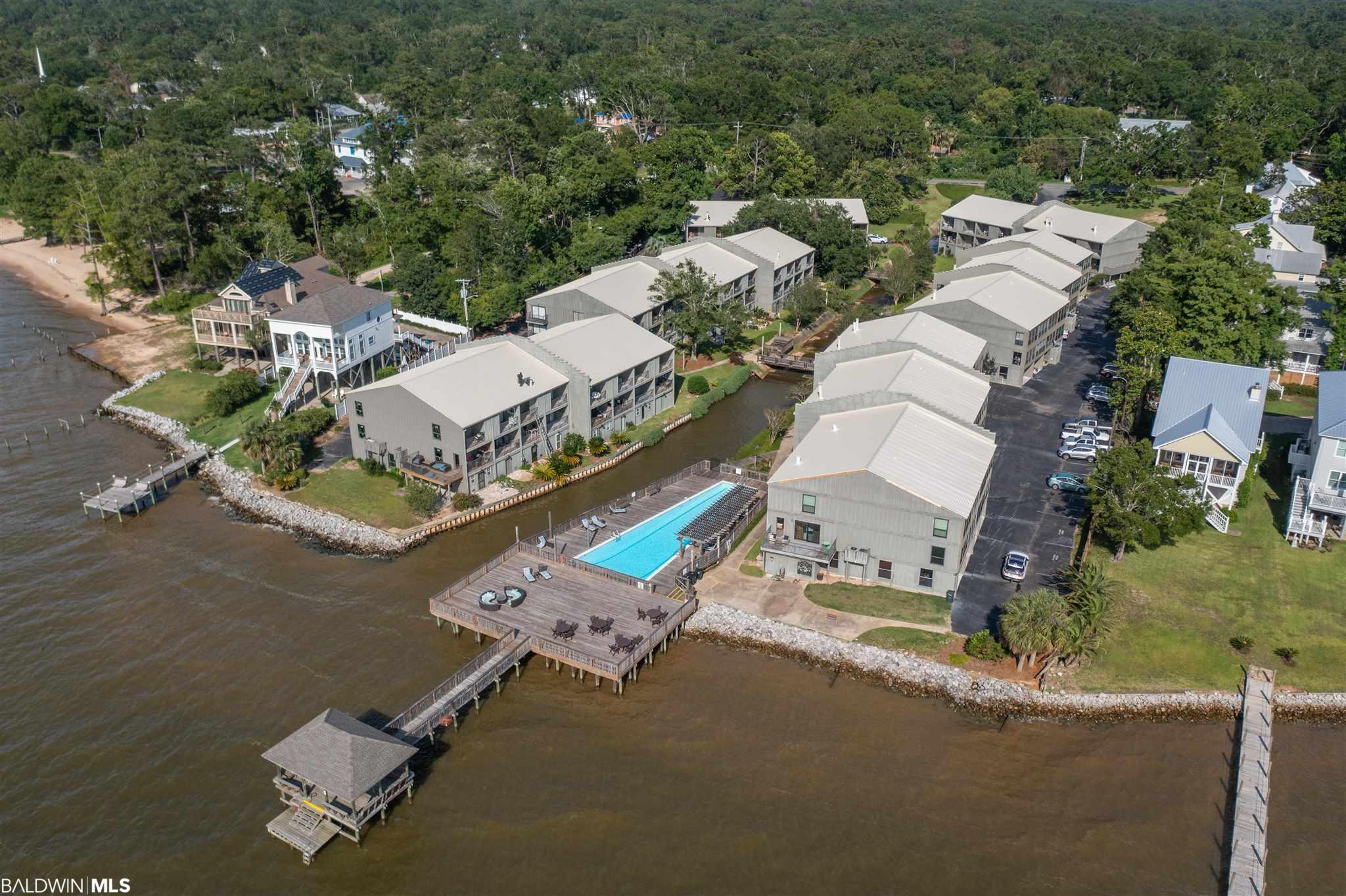 STUNNING Fairhope BAYFRONT TOWNHOME! Enjoy spectacular Mobile Bay sunsets from your very own home! Relax by the saltwater pool, crab or fish from the community pier, relax under the covered gazebo or sit in the sun on the large Bayfront Deck anytime you want! COMPLETELY RENOVATED unit features all new plantation shutters,  updated kitchen w/granite countertops and stainless appliances, upgrade ceiling fans, tile flooring throughtout, crown molding and upgrades throughout! This unit offers 2 bedrooms,2.5 baths, PLUS Lg BONUS ROOM downstairs w/full bath ! As you enter the first floor, you will immediately see this bonus room! It would be perfect for a home office, additional bedroom, bonus room, mancave, or just extra space for your guests! And it even has its own patio for afternoon cookouts!  The kitchen in this unit is beautiful... with granite countertops, custome tile backsplash, large island, custom cabinets, stainless appliances and open to breakfast area where you can watch the sunrise every morning!The spacious den has a patiio which opens to a deck with indirect views of swimming pool and Mobile Bay! The 2nd bedroom offers private bathroom and another deck for morning coffee or afternoon sunsets facing Mobile Bay! Master Bedroom with tiled shower andlarge walk-in closet. Conveniently located along the bayfront walking trail, and just minutes from the Fairhope pier. Take your golf cart tothe many festivals, and spectacular downtown shopping and restaurants that this beautiful town has to offer! HOA fees include commonarea insurance(wind, hail, flood) which covers exterior of entire complex, water, sewer, trash, termite bond, flood insurance, landscaping,pool & ground maintenance. This complex is in a PRIME LOCATION for your primary residence or a second home! PRICED TO SELL