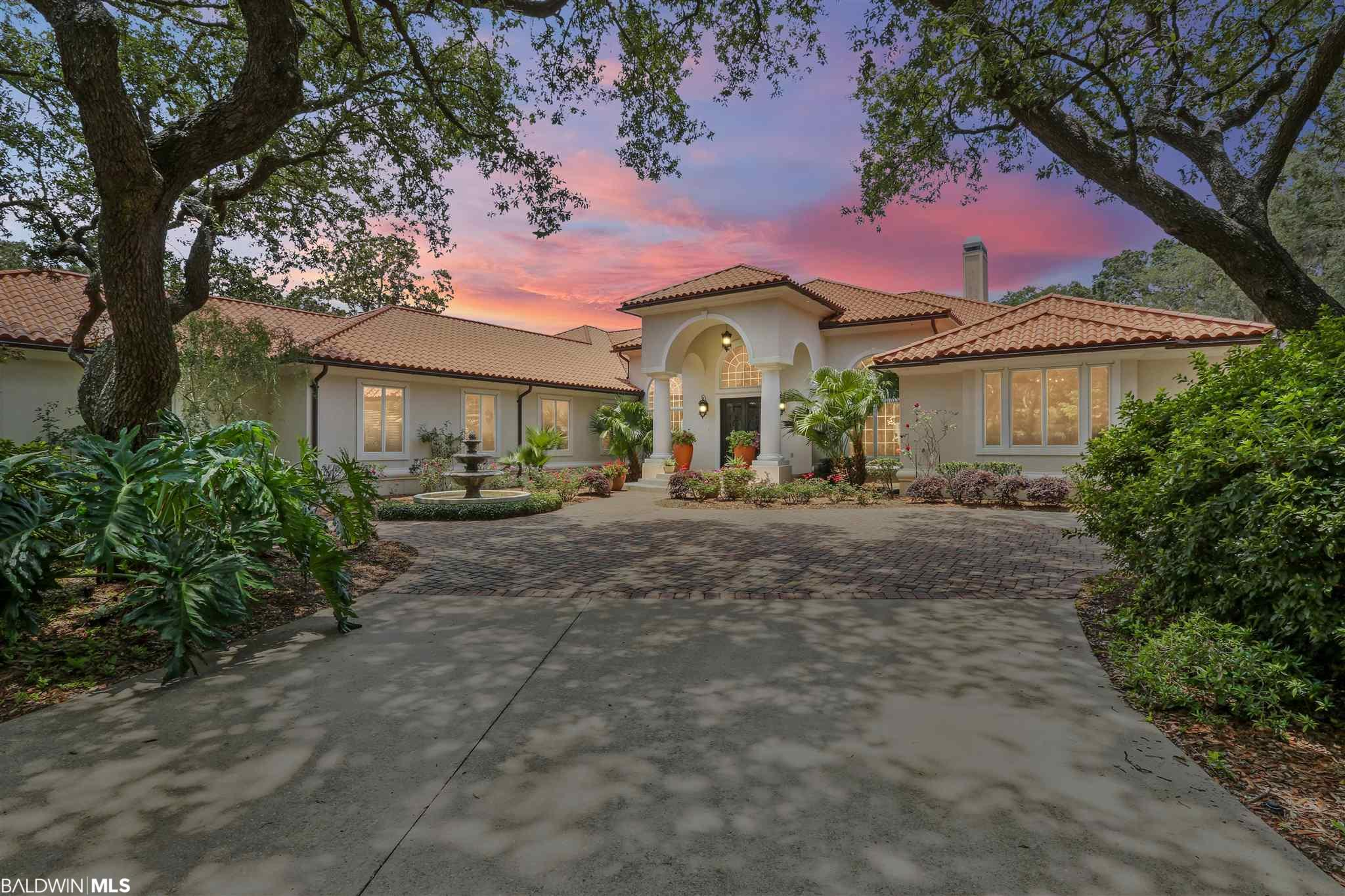 Don't believe them when they tell you, you can't have it all. You can. One of the largest residential parcels of land on Pensacola Bay with 4.6 acres, a 7200 sq ft main house, a separate 3 bedroom guest house plus a caretaker's cottage all elegantly situated on 450 feet of unparalleled bay frontage. Built in 1997 but underwent a massive addition/renovation in 2008.  Enter the grounds of this bespoke estate through the iron gated entrance. Take in the manicured landscaping, the mature trees, the shady brick walkway that leads to the regal iron front doors.  Inside you will delight in the open and sunlit floorplan, where the living and kitchen area nestle up to the screened lanai over the salt water pool and hot tub with ample seating and lounging areas for guests and family. Follow the marble floors to the window-walled sunroom which brings all of the amazing views right to your fingertips and sets the tone for many an entertaining evening. The semicircular glass bar finishes out this stylish space. The chef's kitchen is an epicurean delight with all Thermador appliances, Blue Bahia granite from Brazil, colorful Italian glass light fixtures and an abundance of storage. Retire to the master room wing of the house which features his and hers baths, two sitting areas, walk in closets, stunning views of the pool and bay. Guests will love any of the four guest rooms in the main house, all with views of the bay and private or shared baths. A boat dock with two lifts is ready for your fishing pleasure!  Entertaining a crowd? Not a problem with your separate 3 bedroom 2.5 bath guest house which also has a two car garage.  Living room, sitting room with a fireplace, kitchen and a gorgeous Pergola-covered outside eating area.  But this home is not just a pretty face.  It is perched 25 feet in elevation, has an engineered double sea wall, a safe room in the main house and a generator standing ready to power both homes.