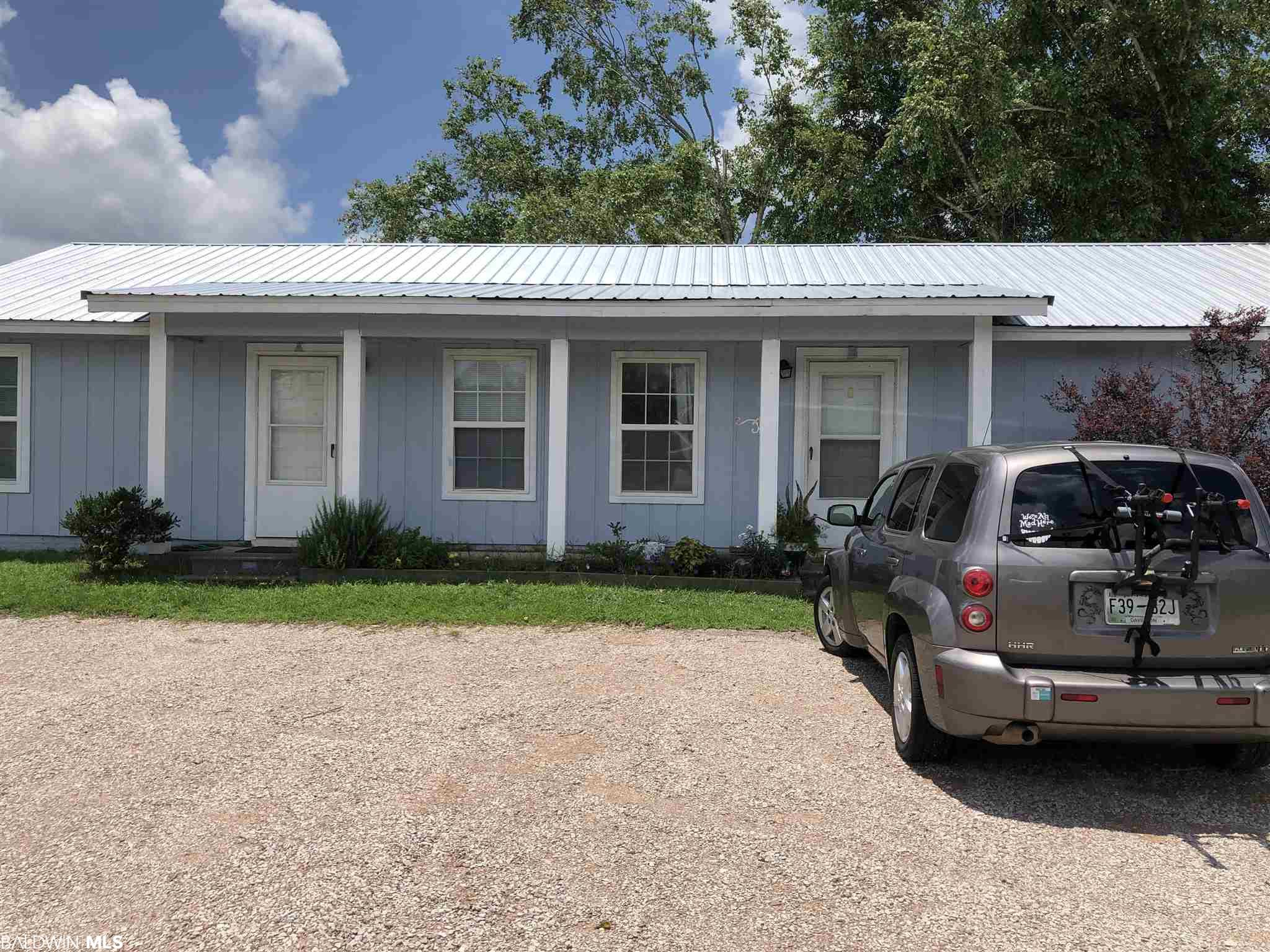 Attention Investors!! TWO Buildings, on Approx. 1 acre of land outside city limits (which means less taxes). Each building has a 2/1 and 1/1. No carpet! All tile and vinyl/laminate. All one level. Roof is metal and less than 2 years old. All tenants are month to month. Live in one unit and rent the other 3 out, or rent all units out. All information provided is deemed reliable but not guaranteed. Buyer or buyer's agent to verify all information.