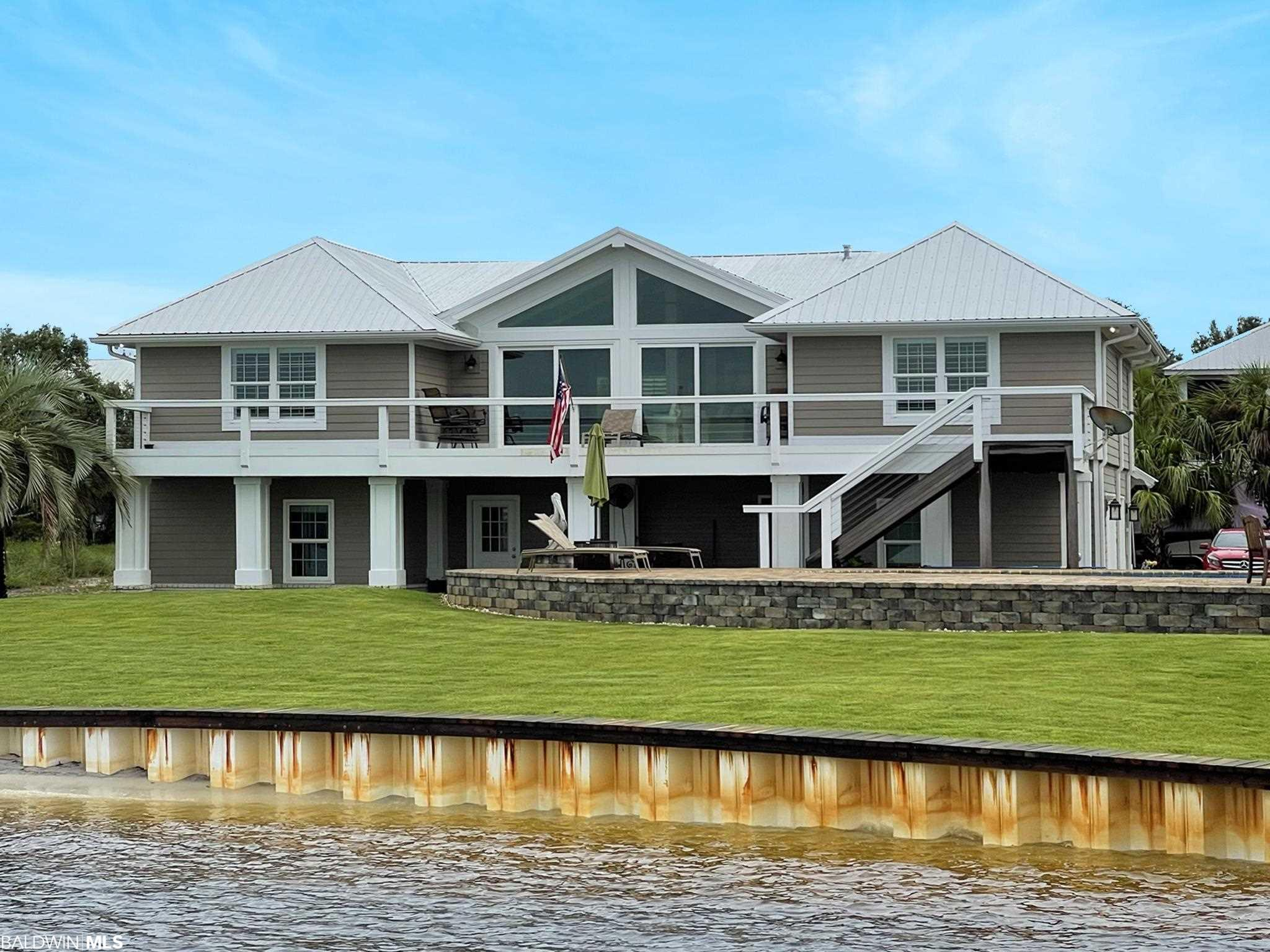 Location! Location! Location is not just a real estate saying... it is real!  This home provides privacy, close proximity to the Gulf for the serious fishing adventurist, close proximity to the entrance of the Island, convenience for a relaxing day at the islands and all the restaurants by boat. This home was completely remodeled in 2014 and sits directly on Bayou Saint John. Boat house built of Brazilian Hardwood complete with two boat lifts (6,000 lb. & 10,000 lb.)