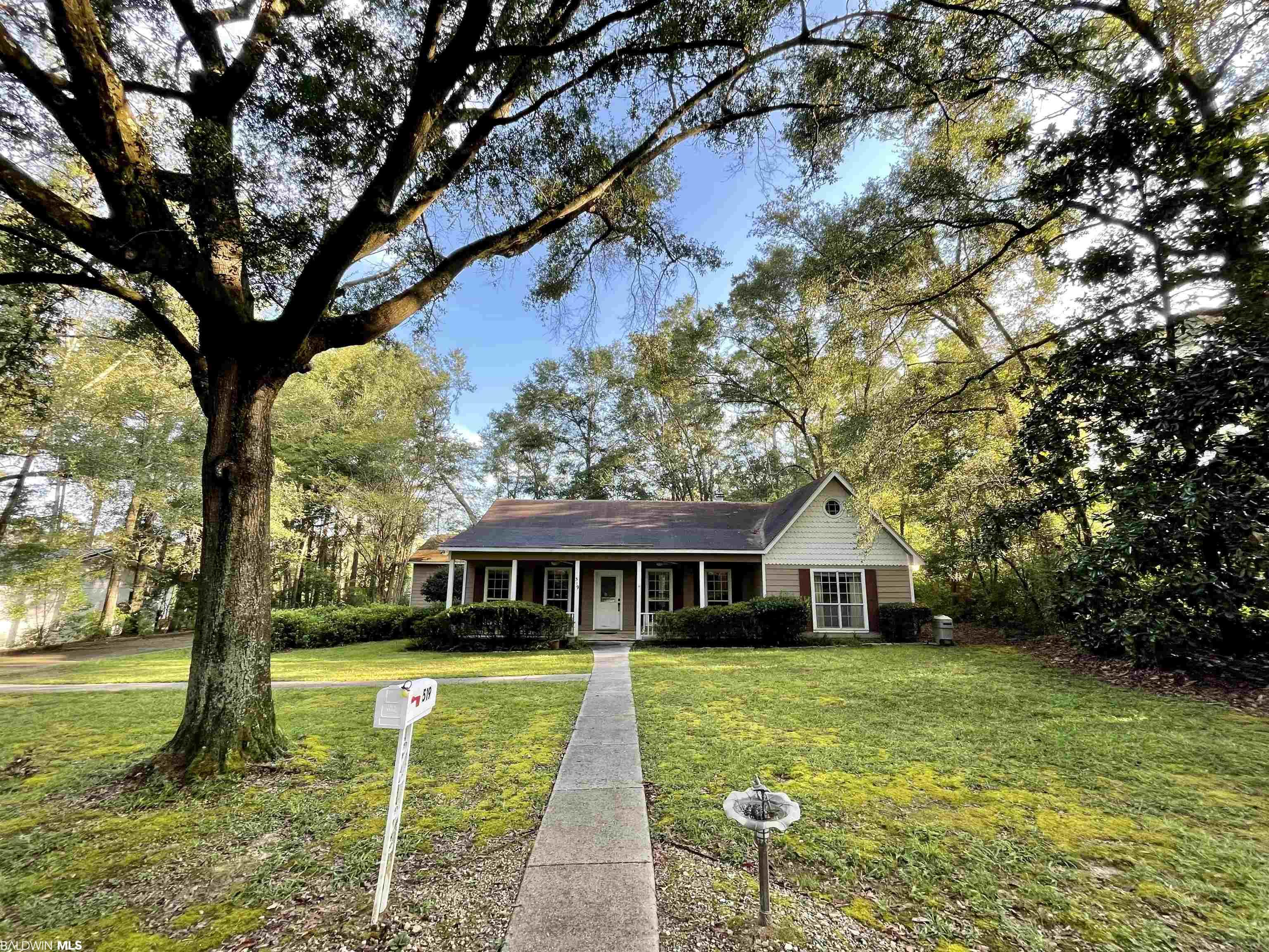 On a quiet cul-de-sac, minutes away from everything downtown Fairhope. Sits this rare find just waiting for your personal touch. This property features over 2,200 sq. ft., a double garage, and 10 foot ceilings throughout. Take a short walk to sunsets on Mobile Bay or dinner at sunset point, just a block away. Enjoy quiet mornings on the wide front porch or inside in the large 22' x 13' sun room. This house has the potential to be your forever home. Schedule your showing today!