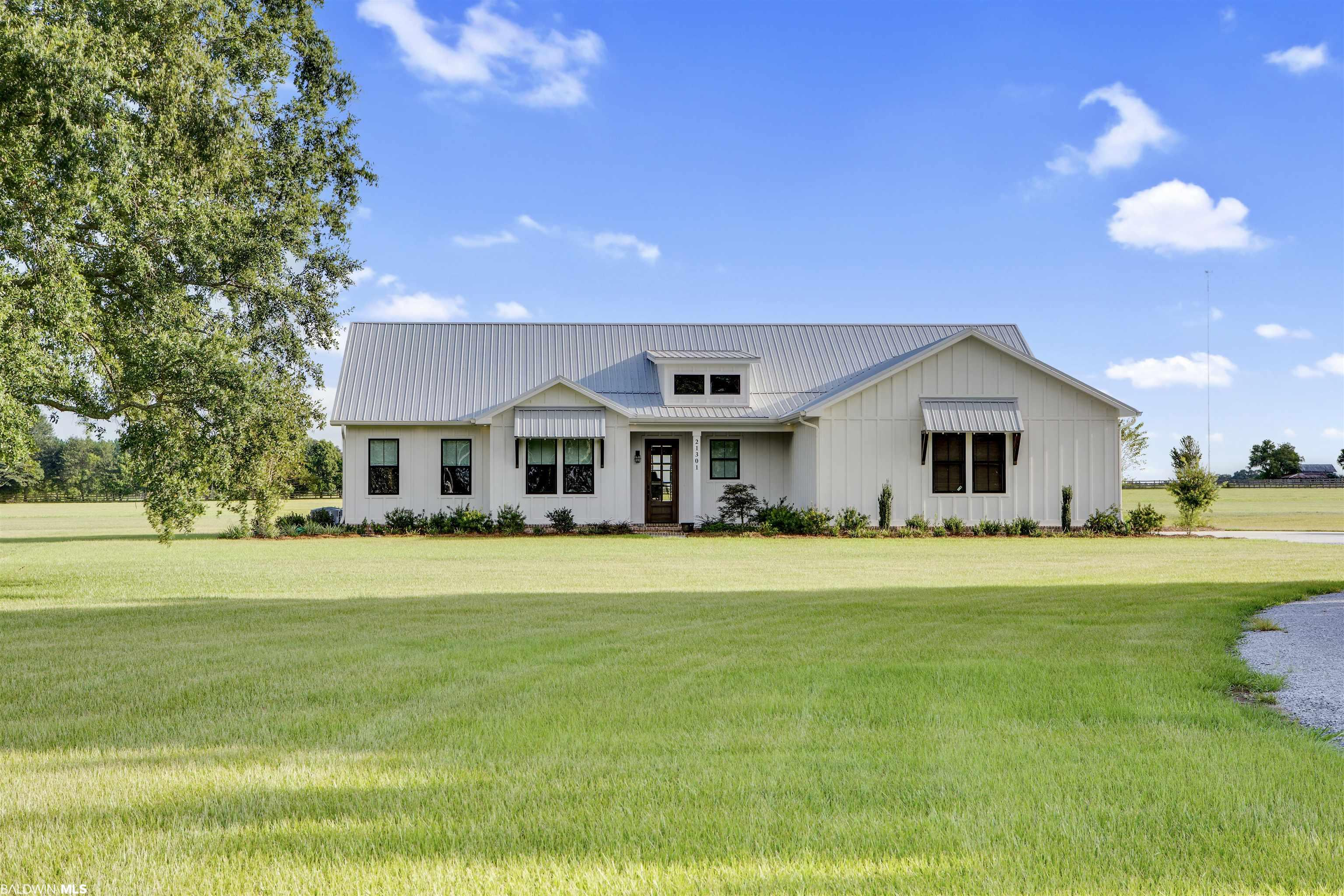 Welcome home to this Gold Fortified new construction farmhouse nestled on fenced 20 acres with plenty of room to expand. This 2856 sq. ft. 4 Bedroom 3.5 Bathroom split floorpan home has expansive bedrooms, bathrooms and walk in closets. As you walk in through the solid wood entry doors you enter the foyer which opens to the great room. Open concept kitchen with island, gas cooktop, double ovens and walk in pantry and office nook. The dining features a built in buffet with custom cabinets, wine cooler, ice maker and wine storage. Natural light is abundant throughout the great room that is adorned with a brick fireplace and custom bookshelves and cabinets on both sides. The back porch off the living room is almost 900 sq. ft. with plenty of shaded space for multiple sitting and entertaining areas and beautiful bricked fireplace. The bedrooms are split with the master suite on one side that features an expansive room, access to back porch, double vanity bath, soaking tub, all tile walk in shower and his and hers closets that are a must see. The laundry room is also accessible from master bath. Opposite side of the house contains the additional 3 bedrooms. Nice size guest bedroom has full bath and walk in tiled shower. Bedroom 3 and 4 are separated by Jack n Jill bathroom which each side has its own vanity and large walk in closets. So many details in this home you must see!