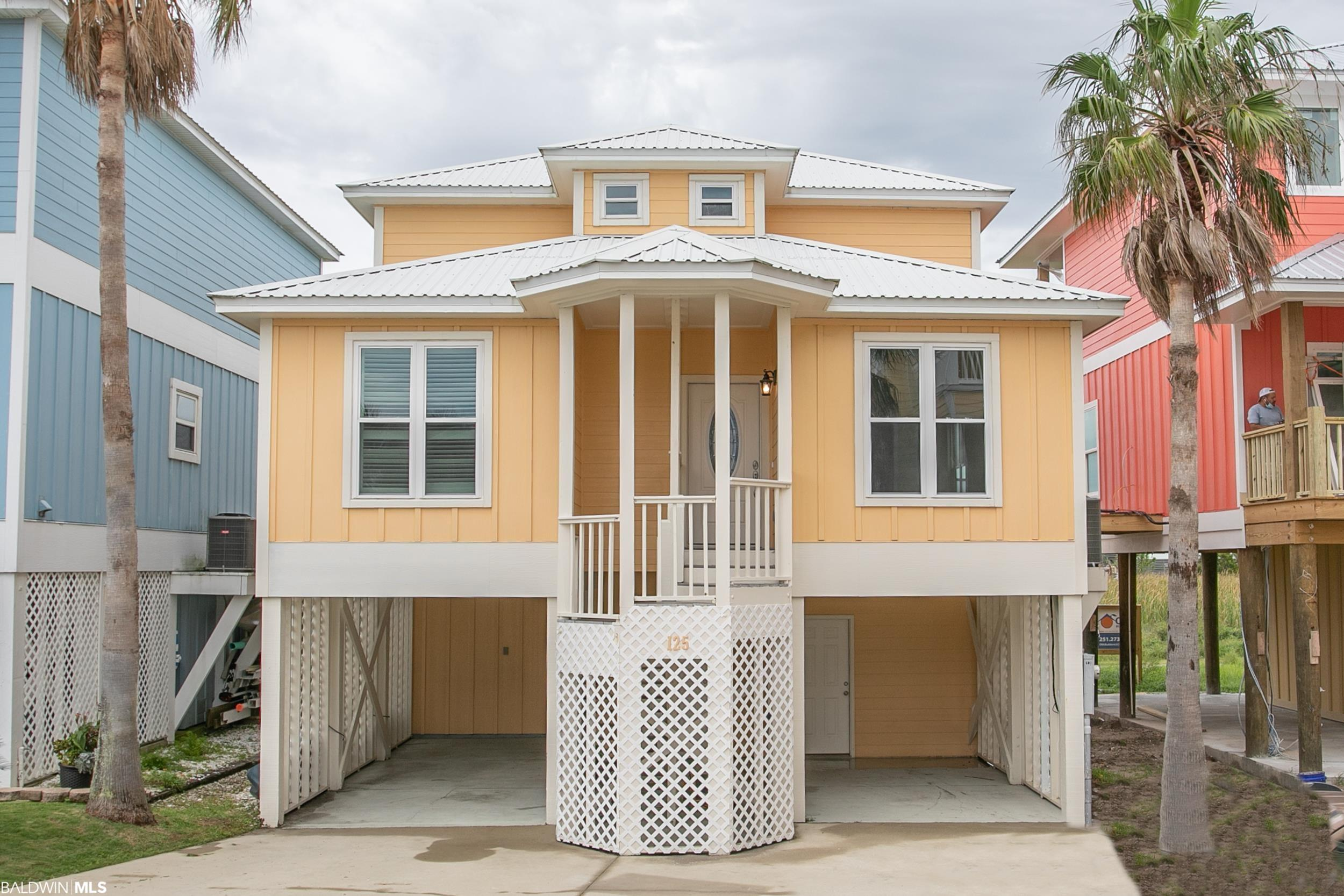 Here is your chance to own a virtually new and beautiful 4BD/2.5BA, 1,762 SF beach home in desirable Blue Lagoon subdivision! This home enjoys views of Little Lagoon from the rear balconies with community amenities to include a Gunite swimming pool, gazebo covered picnic area, and access to a fishing pier and brand-new walking pier over the marsh. Beach access is provided via a short walk either east to 13th Street for public beach access, or west, to Little Lagoon Pass Bridge. This home has undergone major renovations due to Hurricane Sally including new HVAC, laminate and tile flooring, ceiling fans and light fixtures, fresh interior paint, new trim and doors, hurricane rated sliding glass doors, central vacuum system, and more. The kitchen is open to the dining area and living room and will feature all new cabinets and granite countertops. Stainless steel appliances are provided to include a refrigerator and wine cooler. The spacious master suite includes a walk-in closet and double vanity, granite countertops, large tiled stand up shower, and plantation shutters in the bathroom. Approximately five years ago the exterior was replaced with hardiboard, all new windows installed, and all metal roof screws/grommets replaced. The bottom level includes approximately 325 square foot of heated/cooled recreational space and there is also a large storage room for all of your beach toys. The new washer/dryer as well as the TV in the bonus area will convey with the sale.