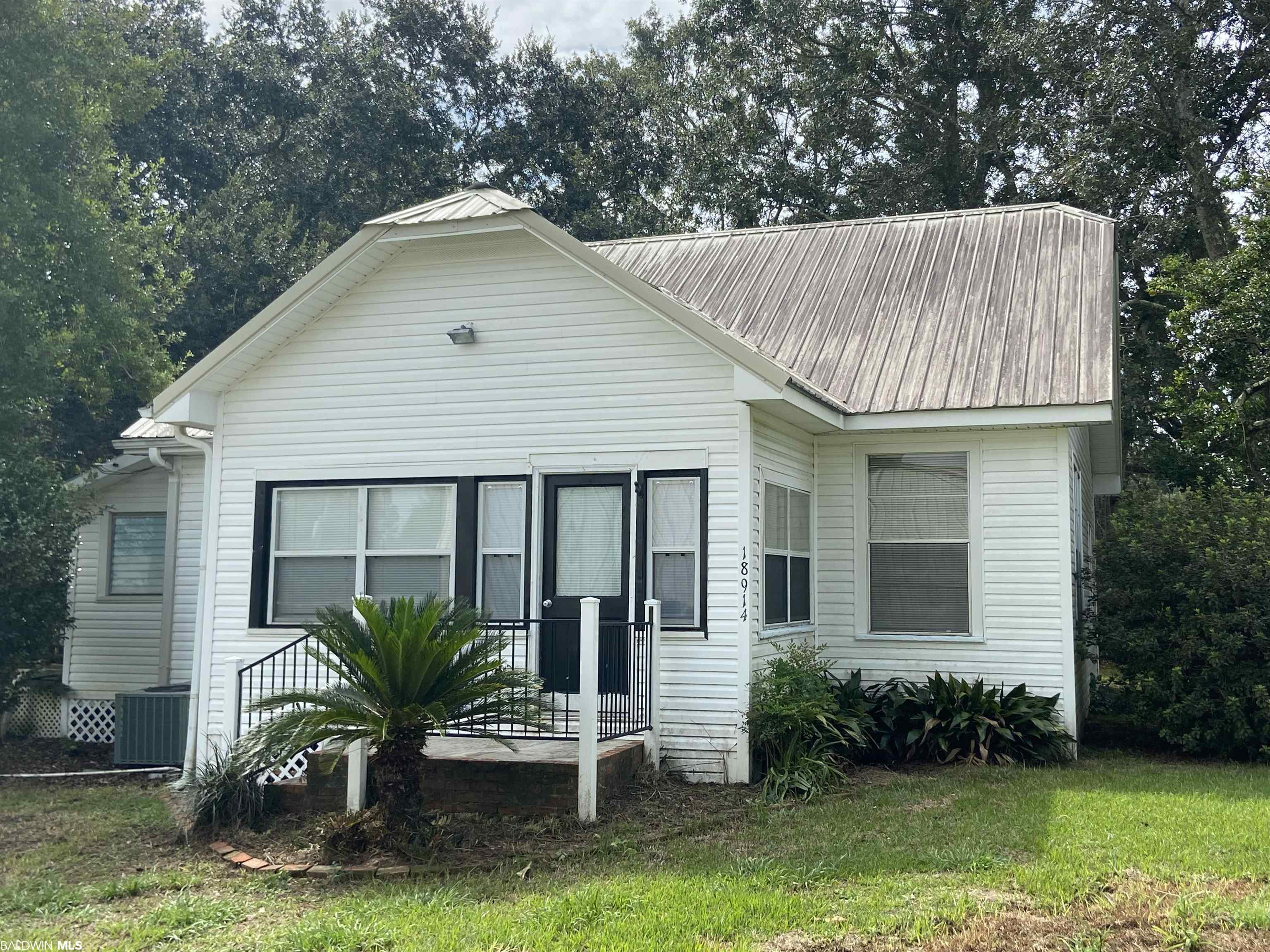 Buy the cutest cottage in Baldwin! This one is loaded with charm and ready for a new owner. Located on a quiet street central to Robertsdale Elementary and Robertsdale High School, this one is  completely refreshed on the inside--new cabinetry and countertops, new vinyl plank flooring, and fresh paint make this one a must see. The property has a spacious yard with storage shed and an RV hookup! Home has been replumbed and rewired prior to current owner. Information is deemed reliable and should be verified by buyer or buyer's agent. Seller is licensed real estate agent.