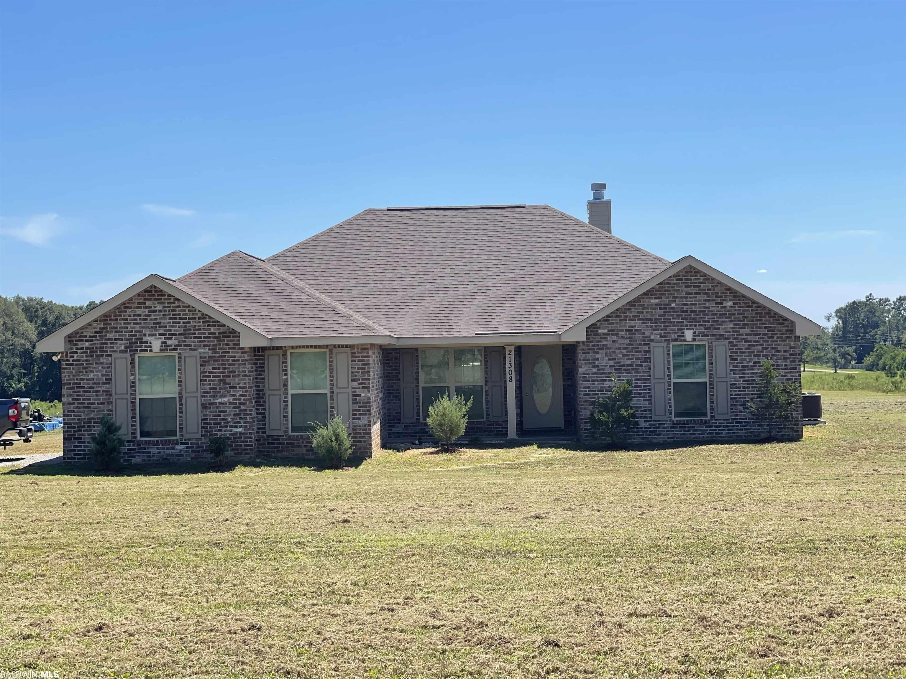 This beautiful 2020 build on 5 acres is an absolute MUST see!! It has a gold fortified roof that survived Sally with absolutely NO damage and the home is still under its 1 year builder warranty!! If you are looking for peaceful, country living while still being close to everything then this mini estate is perfect for you. There are also many horse farms nearby!! The inside of this beautiful home has a great split floor plan, formal dining, eat in kitchen, 2 car garage, covered patio, large bedrooms, and granite countertops in the kitchen. Again, this property is a must-see and won't last long!