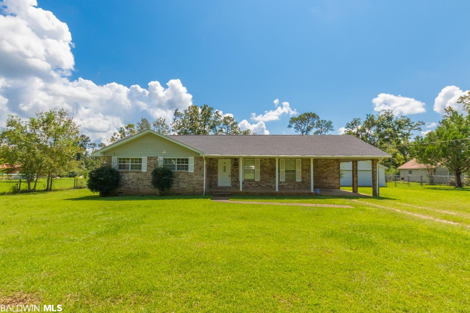 Great ranch style home on 1.3 acres near Magnolia Elementary School now available! NEW ROOF! Home has a great layout with 3 bedrooms, 2.5 baths, a separate utility room and den. Carport attached to home makes it convenient for unloading groceries right into the kitchen. A new wood deck was installed in June of 2021, while there is also a screened-in area, perfect for enjoying the outdoors all times of the year! The detached workshop is a great space for storage and/or hobby space. Subfloor is exposed in some areas, leaving room for you to install your preference of flooring. New toilets in master bath and 1/2 bath. Home is sold AS IS, WHERE IS. Foley is a growing city with a quaint downtown area. Shopping, schools and the beach are minutes away! Don't let this one pass you by!