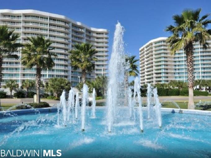 Luxurious Upscale BAYFRONT Condo Located In One of Orange Beach's Most Desirable Complexes. This One Won't Last. This Beautiful Three Bedroom Three Bath Condo Features Gourmet Kitchen With All Stainless Appliances, Granite Countertops, Custom Cabinetry and Fixtures, Wet Bar With Sink and Icemaker. Spacious Private Balcony Offers Breathtaking Views Overlooking Both The Bay. Relax, Unwind and Enjoy! Spa-Like Master Bathroom With Dual Vanity His/Her Sinks, Jacuzzi Tub and Walk In Custom Tiled Shower. Assigned Covered Parking. Caribe Resort Is Like No Other. This Complex Offers 40,000 Square Feet of Indoor / Outdoor Pools, Lazy River, Tennis Courts, Saunas /Steam Rooms, Game Room, Playground, Exercise Room, Putting Green, Tennis Court, Private Beach Cart Service, Five Star Restaurant and So Much More! Don't Miss Out On Your Opportunity To Own A Piece of Paradise.