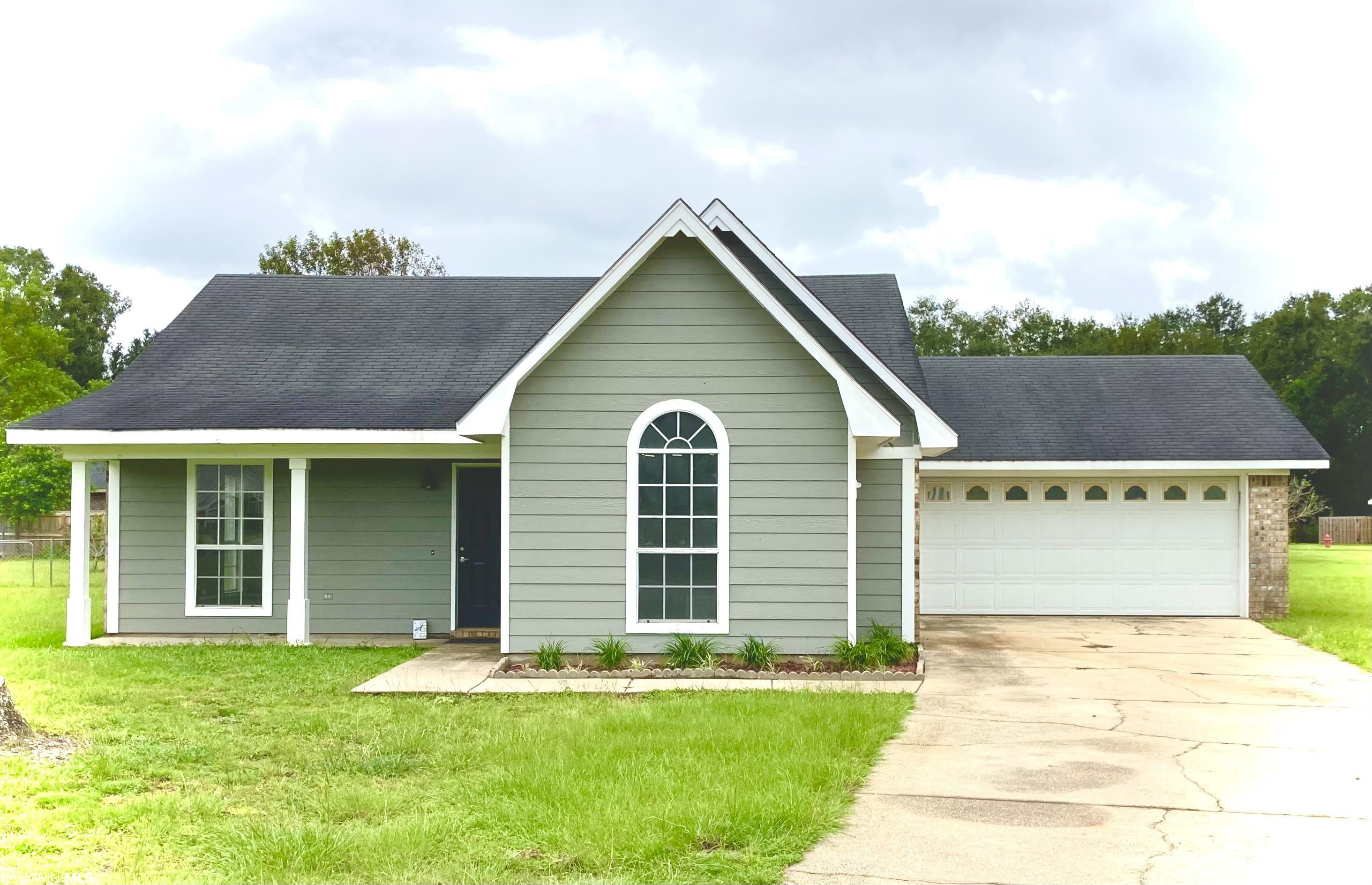 Nicely updated 3 bedroom / 2 bathroom Brick & Masonite home in Foley, Alabama, at the end of a culdesac! Neutral colors throughout. New flooring and freshly painted. NO CARPET. Large Fenced in Back Yard with Covered Patio. Attached, 2 Car Garage. Great Location: A mile +/- to the new OWA Theme Park, Restaurants, Tanger Outlet Mall, Less than 20 minutes to the Sugar Sands of Orange Beach / Gulf Shores, Gulf Coast Zoo, Jack Edwards National Airport, and approx 40 minutes NAS Pensacola!