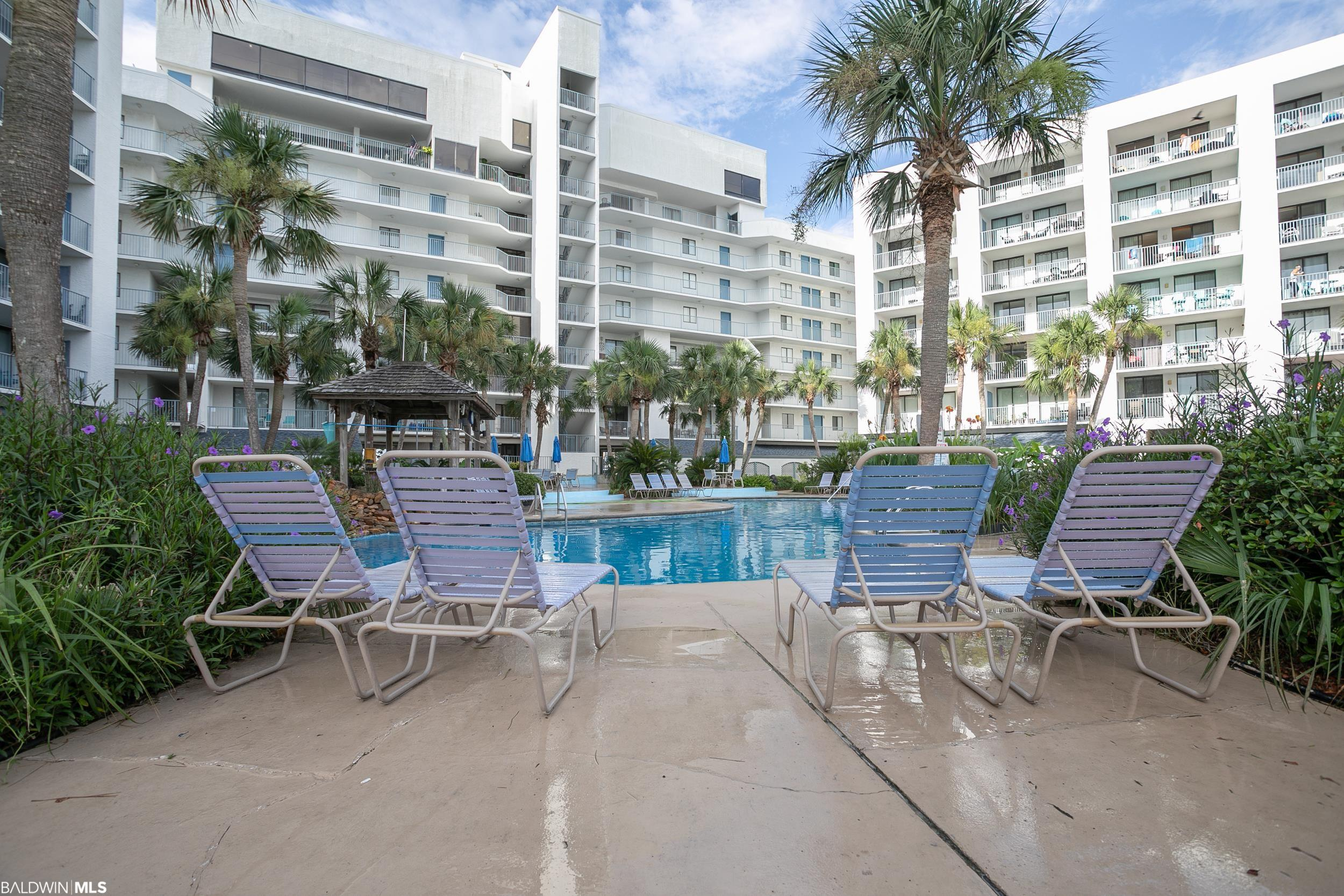 Have the best of  both worlds! Private gated beach access and views as well as a  lagoon access and views. This is a East end unit at Gulf Shores Surf and Racquet club featuring double balconies with Gulf and Lagoon views. This non-rental unit is immaculate, bright and comfortable. The bedroom features a lagoon view balcony with floor to ceiling sliding glass door, New king mattress and double dresser. The bathroom has been completely re. New tub shower combo, new toilet and vanity. There is pretty driftwood style laminate flooring in the kitchen, bath and halway and brand new carpeting in the bedroom and living area. This condo has been recently painted too! The living dining area features an additional window on the east wall and floor to ceiling sliding glass door with custom blinds that brings in lots of light and offers Gulf views. Take your living outside on you ample size gulf view balcony to enjoy meals, coffee or an afternoon beverage. A very comfortable couch and TV console with fireplace will make those cool fall and winter days oh so cozy. 1 year old stainless appliances in kitchen and newer full size stack washer and dryer and hot water heater. BRAND NEW HVAC systems inside and out. 2 beach bikes and a tandem kayak convey. Ready for you to enjoy or share with guests. This complex is a rare find. The property sits on little lagoon with 2 piers. Peir 1 features 1st come ,1st serve boat slips, boat ramp, fish cleaning station and is just a great spot to enjoy the wildlife. Pier 2 is the perfect spot for relaxing and enjoying amazing sunsets. Private gated beach access is just across the street. The pool area is beautifully landscaped with a hot tub, water feature and gazebo. In addition there are 2 lighted tennis courts, a shuffleboard court and 2 grilling areas. Boat and trailer storage lot too! To top it off the HOA is  very well managed with low low dues and a awesome friendly staff.