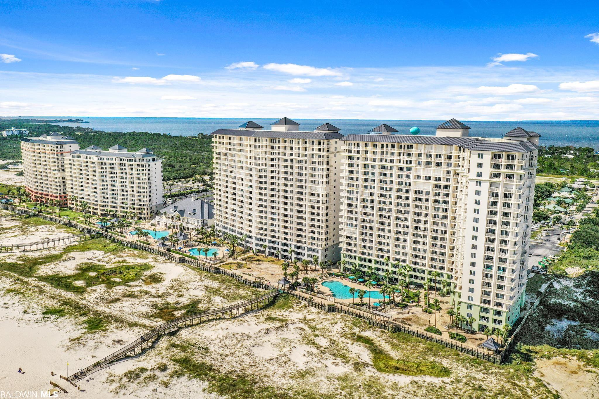 Peace and tranquility await at The Beach Club in Gulf Shores on the Fort Morgan Peninsula! Unit A1704 is a 17th floor condo located on the Gulf of Mexico and offers gorgeous waterfront views of the white sandy beaches. This well appointed 3 bedroom 3 bathroom furnished condo has a neutral pallet and is move-in ready. Amenities galore at The Beach Club: gulf-front clubhouse is the hub of activity featuring 26,000 square feet, award-winning seasonal Coast Restaurant, seasonal Gulfside Bar and Grill, full service Spa & Salon, outdoor pool, indoor pool, kiddy pool, Fitness Center, GameRoom, and Locker Rooms. The Racquet Club has 8 rubico tennis courts, including 2 lighted courts and a pro shop; the Activity Court has basketball and shuffleboard courts. Lots to do--walking paths, bike rentals, kids' playground and the nearby 7,150-acre Bon Secour National Wildlife Refuge. Optional Club membership. Club amenities require membership. New HVAC. Minimal hurricane damage to this unit. A great investment property, this unit brings in $50K+ annually in rentals.