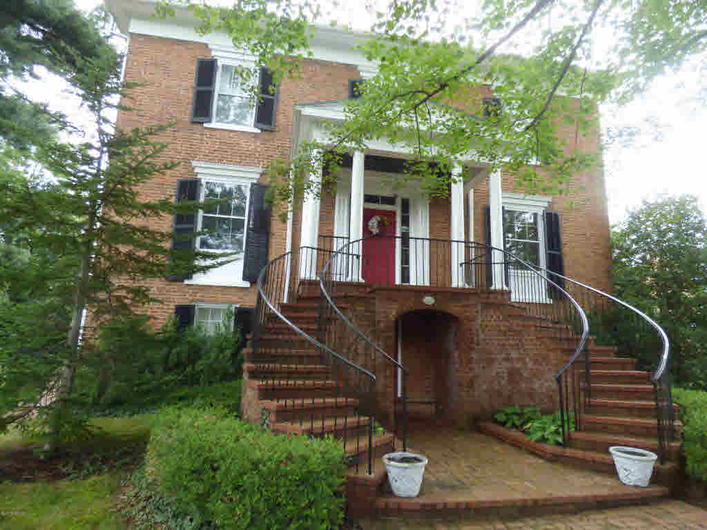 One of Wytheville's most prestigious homes is now being offered. This historic gem sits in the heart of historic downtown with easy access to restaurants, farmers market and shopping. Built in 1835 this stately home offers a beautiful central hallway with formal living and dining rooms, large den with lots of windows, chefs dream kitchen with solid surface counter tops and high end appliances. This home has 3 bedrooms, 3 and 1/2 baths and a elevator to access all floors easily. It sits on a large corner lot with beautiful landscaping and mature trees. The home has beautiful pocket doors with pine and walnut used in the woodwork throughout the house.