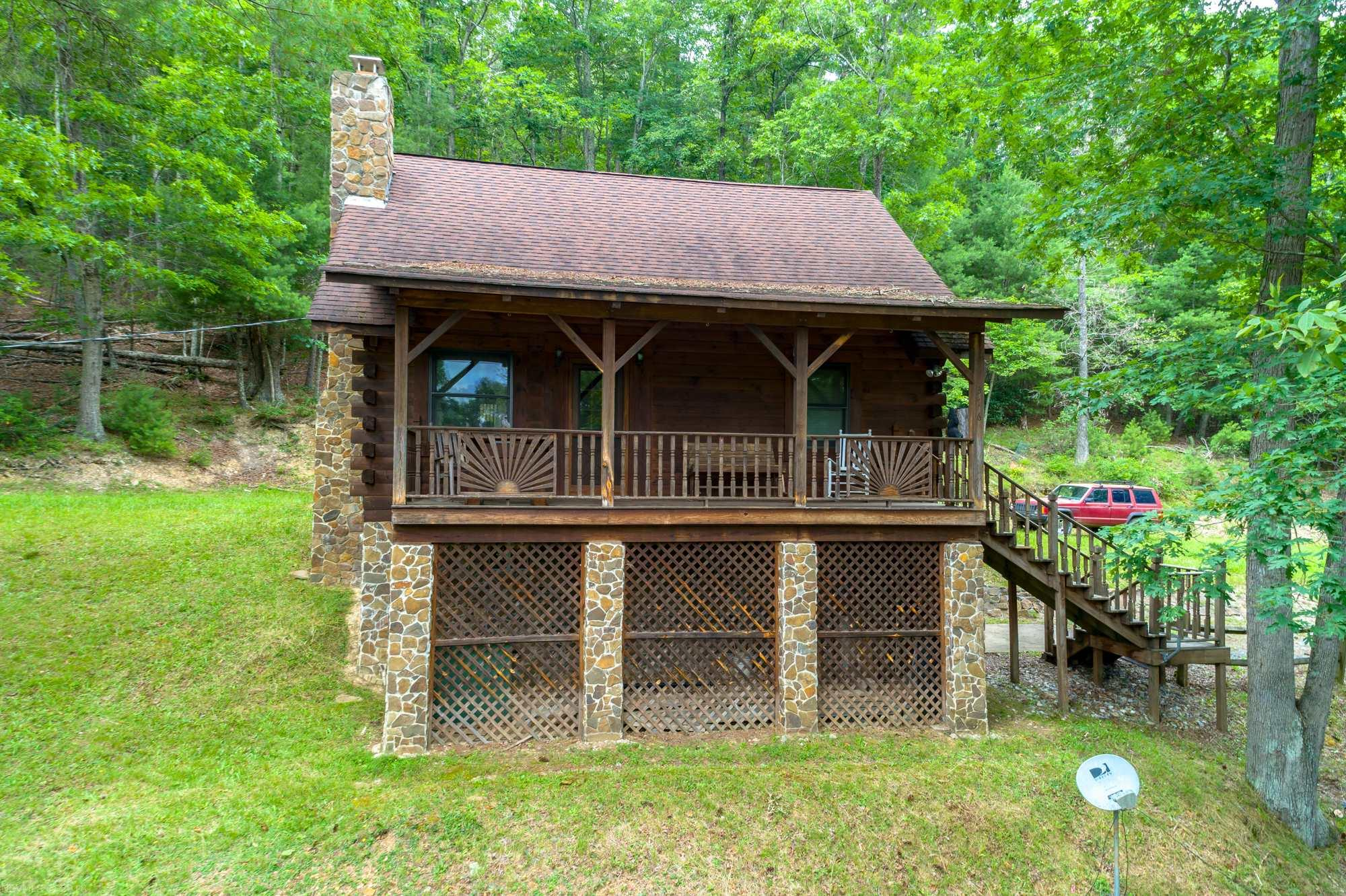 2 BR 2 BA cabin on just over 66 acres in Bland, VA. This property is absolutely perfect for the outdoor enthusiast that loves to ride four wheelers, hunt, enjoy nature and simply be away from everyone, and though it could be a full time residence, it is ideal for a recreational getaway for you and your family to enjoy in the mountains of Southwest VA. Not only does it border the Jefferson National Forest, but has creek frontage as well and there are multiple hunting plots with blinds and trails to ride too. Cabin is quite nice and has a full kitchen, large living area, a very nice fireplace, heat pump, and more. Garage in basement. Located only minutes from I-77, not far from the WV/VA state border.
