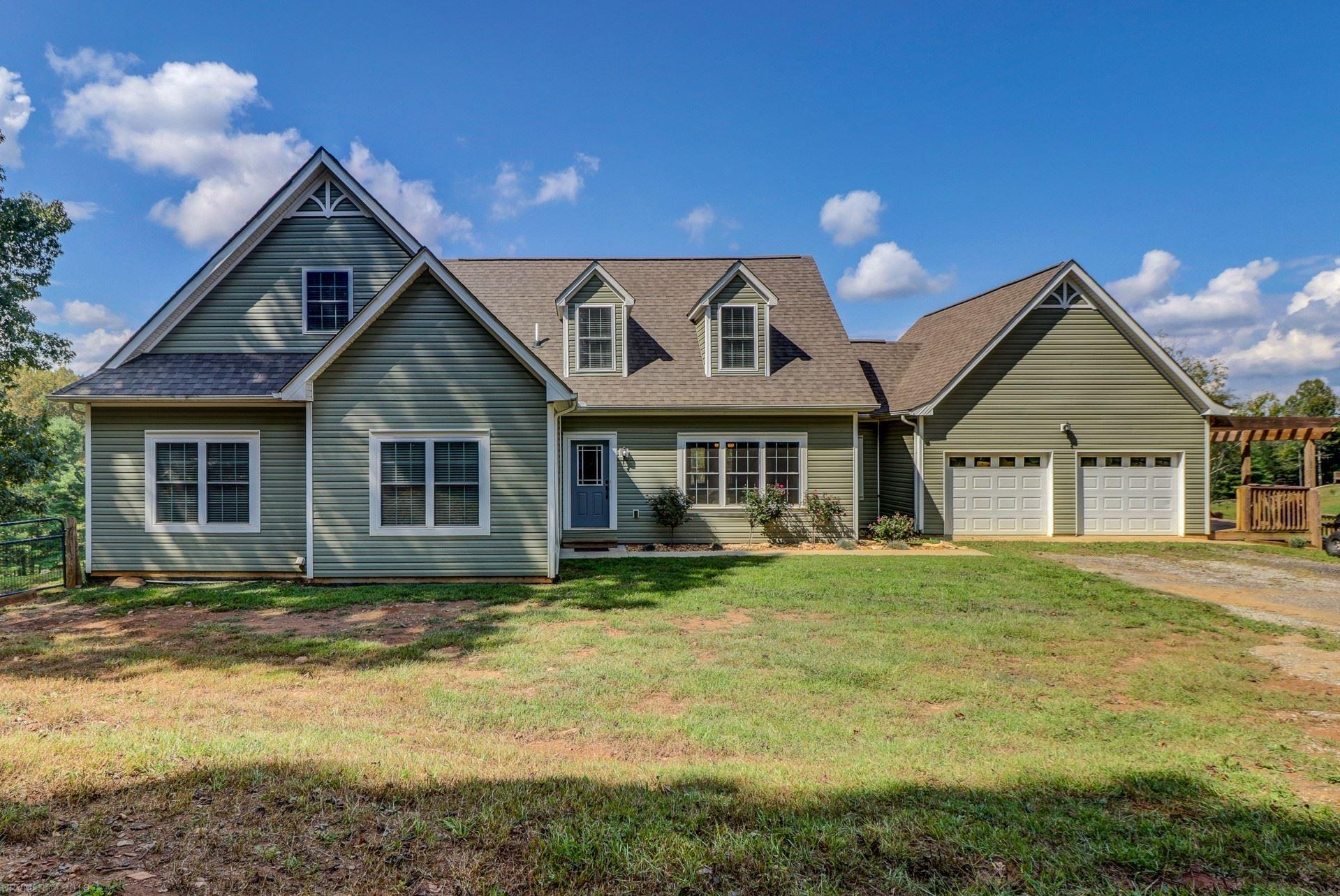 Highlighted by hardwood floors, Ceramic tile, Granite countertops, 2 master suites, 2 fireplaces including one in master suite, a two car garage, Spacious great room and large deck (1,100 sqft) set on 7+ private acres. Two car detached garage with heating, air conditioning, water & cable.