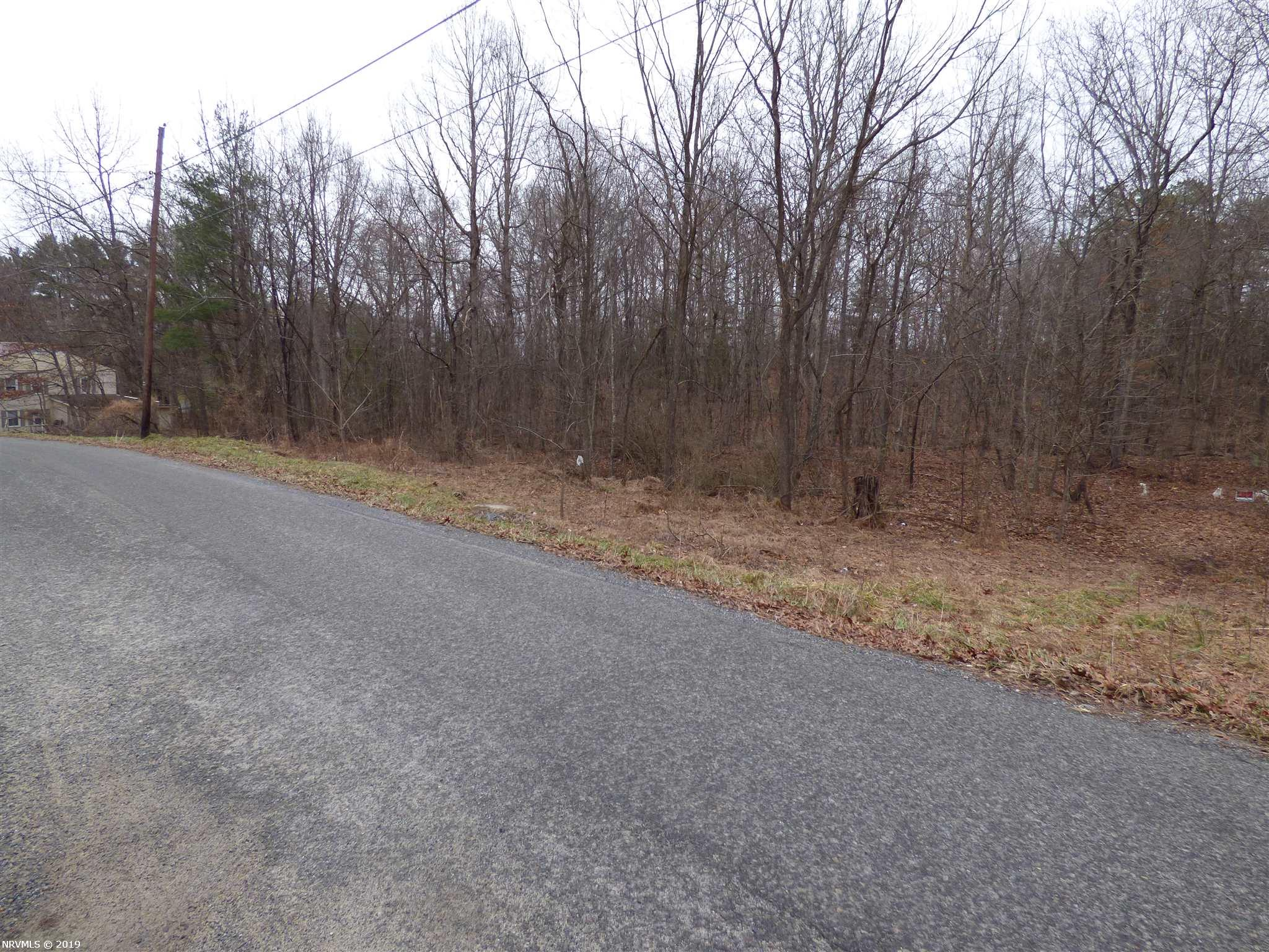 Nice wooded lot with county water/sewer. No restrictions. Owners/Agents
