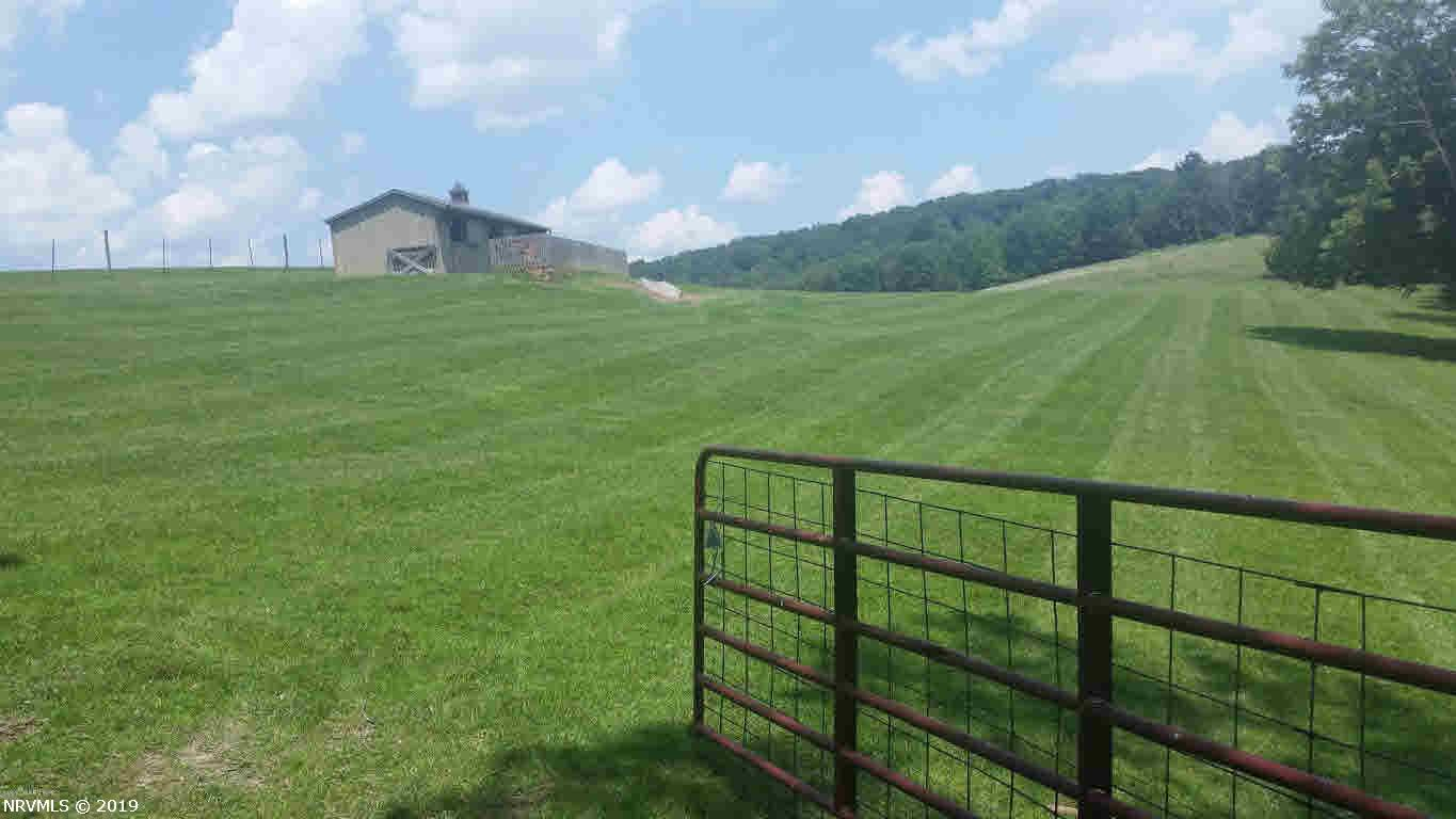 Beautiful rolling farm land, some pastures, some wooded. Views of the mountains and great privacy.  Three small barns with electricity.   In addition to road frontage on Hurston, there is a 50 ft. ROW off Peak Creek Rd. Water is currently run to the 3 barns from Lot 4 (cottage) and seller will grant short term use to buyer until buyer can drill well.  Total of 88 + acres,  fencing, cross fencing, pond.  Perfect for an equestrian center.