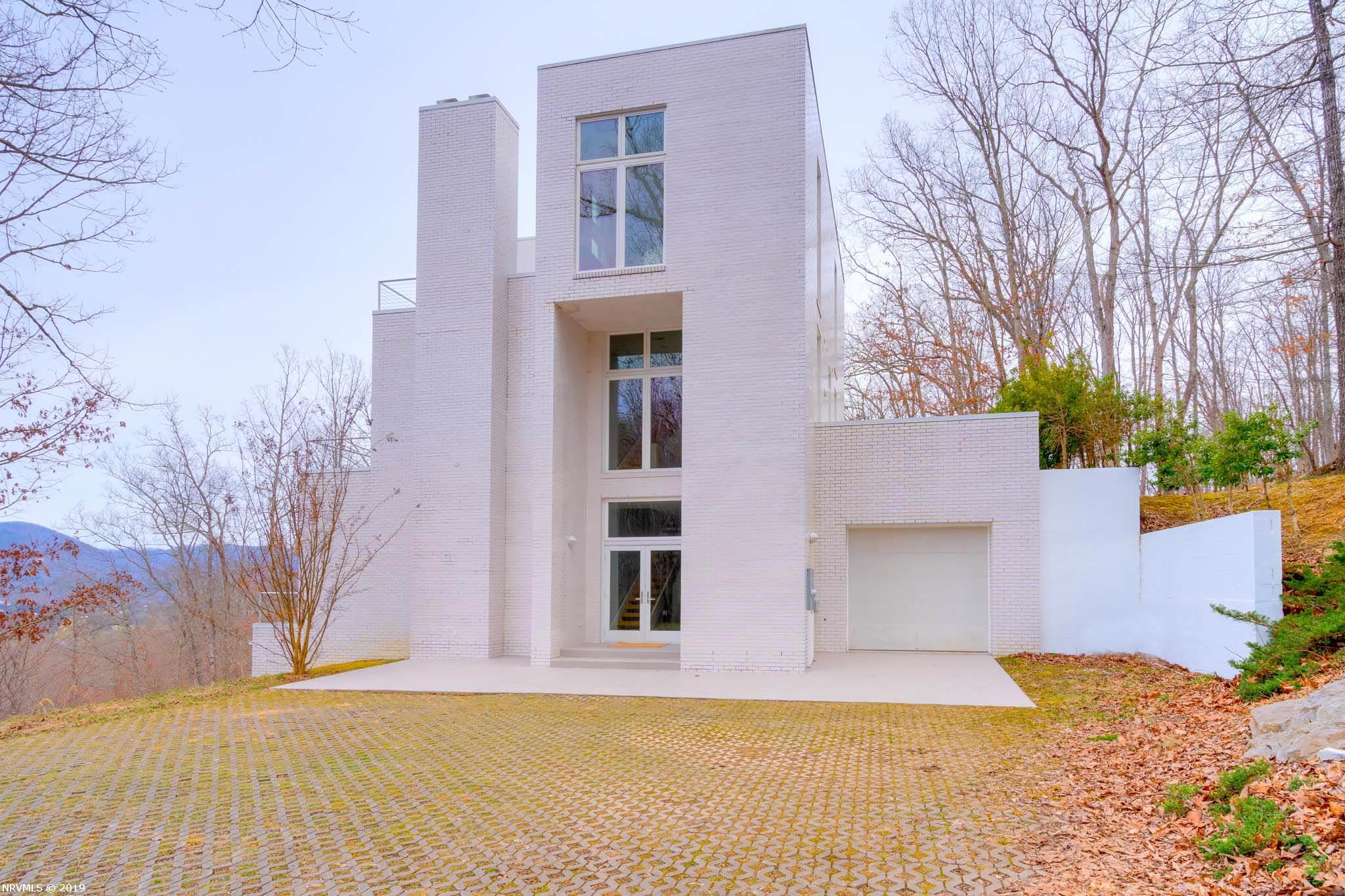 Air BnB before you buy! AIA NATIONAL AWARD WINNING CONTEMPORARY OFFERED FURNISHED OR UNFURNISHED AND IS AN ACTIVE AIRBnB!  Nestled in heart of the Blue Ridge, Deercroft is one of Blacksburg's most elite neighborhoods, providing the best of town and country living (3 miles from downtown / Lane stadium, 1.5 miles to the Blacksburg Country Club). The Deercroft House boasts some of the best views of multiple mountain ranges from EVERY room in the house. A floating staircase spans 3 stories, and serves as a beautiful core in this one of a kind, custom built, porcelain brick exterior home. Owners gutted the kitchen down to the studs and installed a brand new kitchen, replaced some windows and doors and enhanced the homes weather proofing in 2018. A paved private shared driveway is maintained by homeowners association. Easy access to Virginia Tech, VCOM, VT Corporate Research Center and also minutes to Roanoke and all New River Valley destinations.