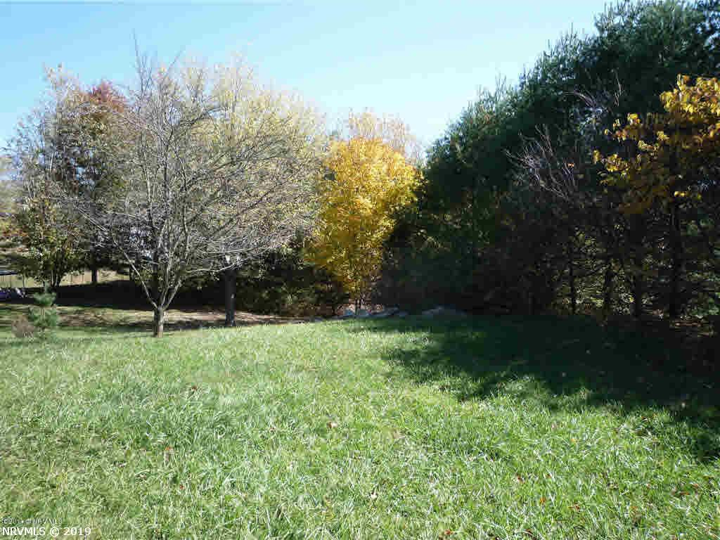 Outstanding opportunity to build in a beautiful tree lined neighborhood and also enjoy joint ownership of the 28 acres surrounding the homes.  Few lots are privately owned so this a rare opportunity! Conveniently located to schools, shopping and transportation with hook up to natural gas and public water available. Take advantage of this opportunity to buy now and build later!