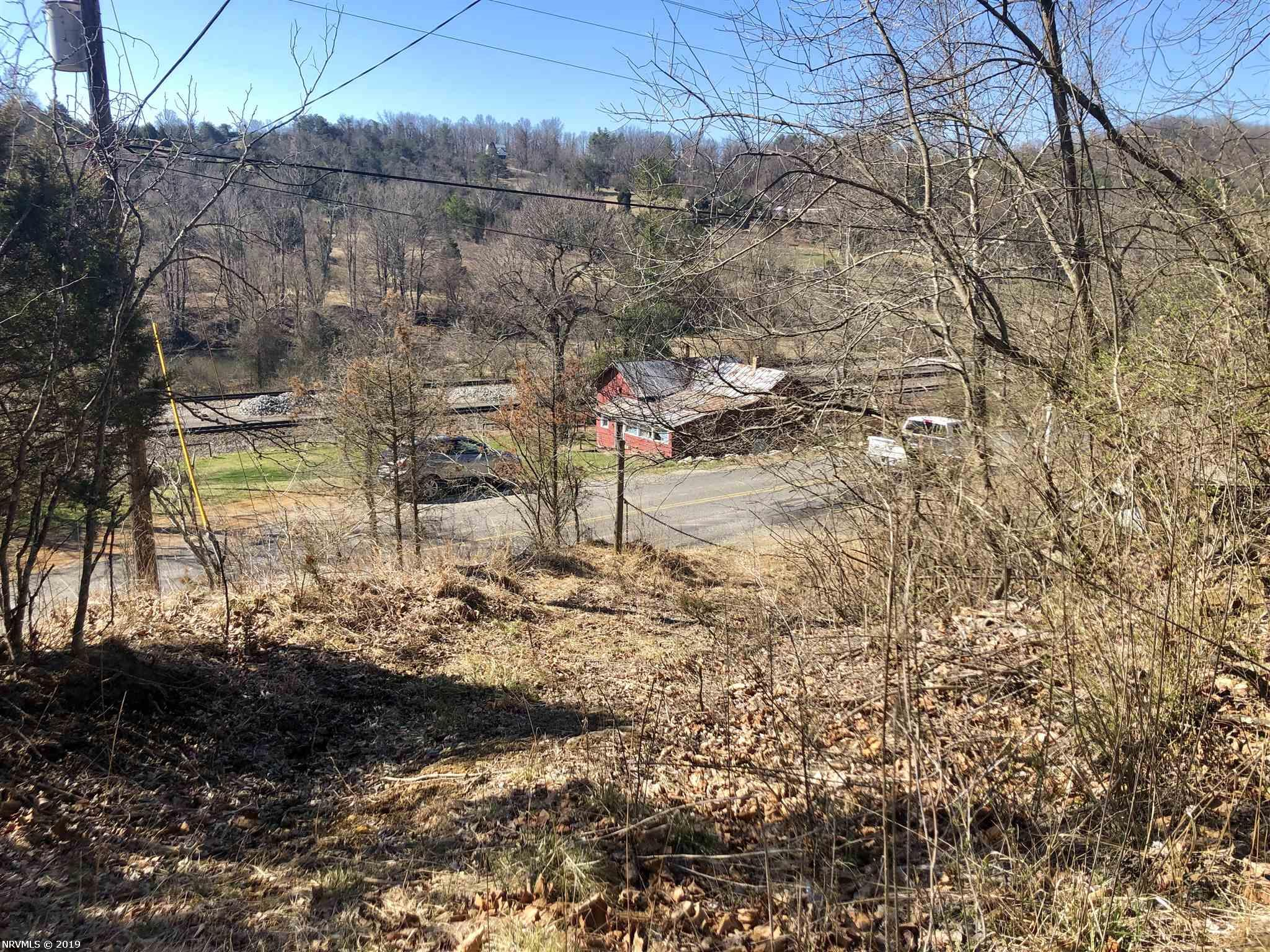 "Close to town with country setting. Great opportunity to purchase 10 acres of land conveniently located off Rt. 114 with amazing mountain views. fronts on paved, state maintained, Vicker Switch Rd. House conveys at ""no value""."