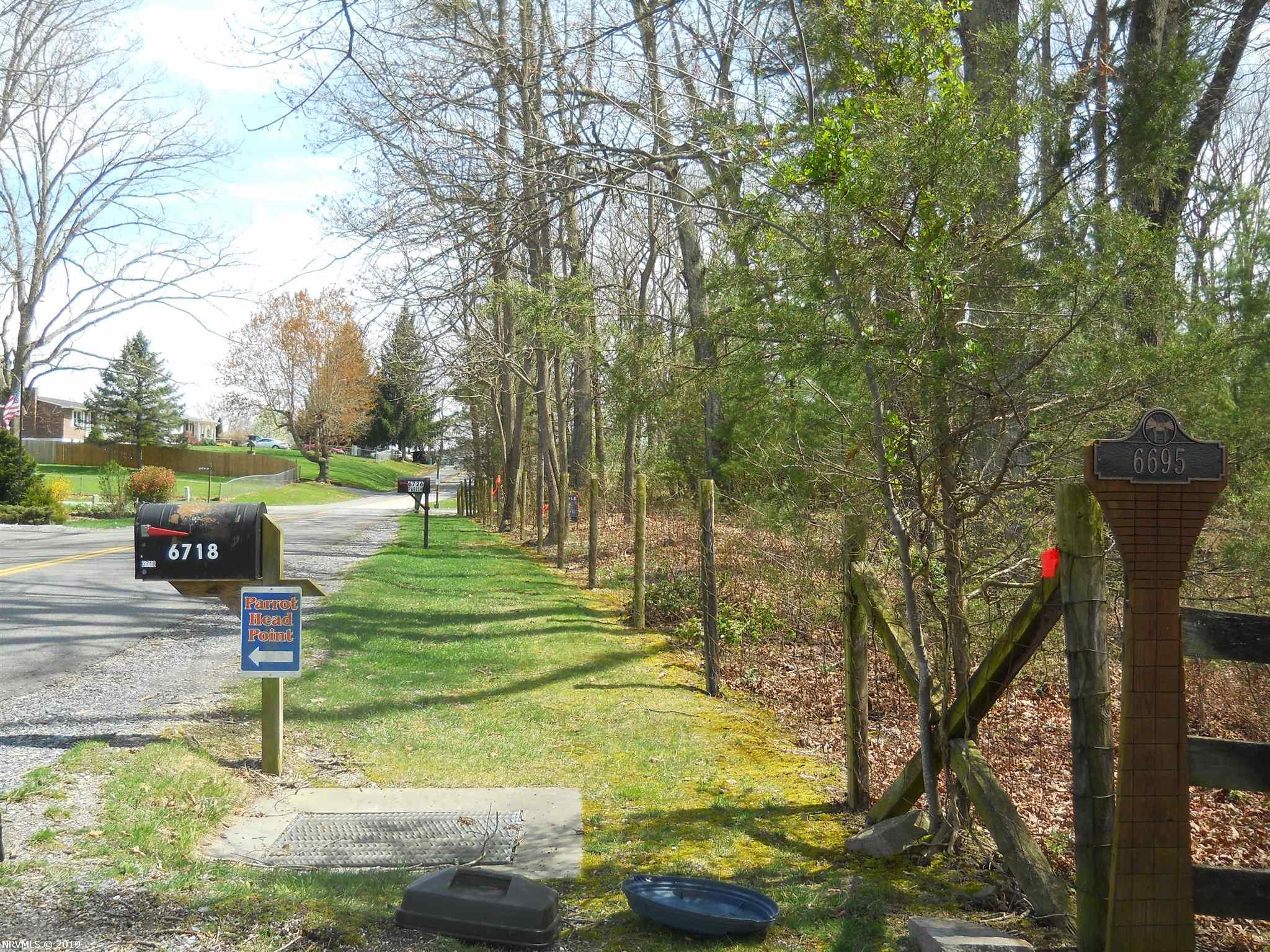 BEAUTIFUL BUILDING LOT, LEVEL, MATURE OAKS! DEEDED LAKE ACCESS TO THE LAKESHORE LAUNCH AREA FOR YOUR BOAT OR PWC!. EACH LOT HAS APPROXIMATELY 105 FEET OF ROAD FRONTAGE.  SOME RESTRICTIONS. ONLY 5 MINUTES FROM THE STATE PARK AND BEACHES AND ALSO TO I 81!  FIRST TIME EVER OFFERED FOR SALE!