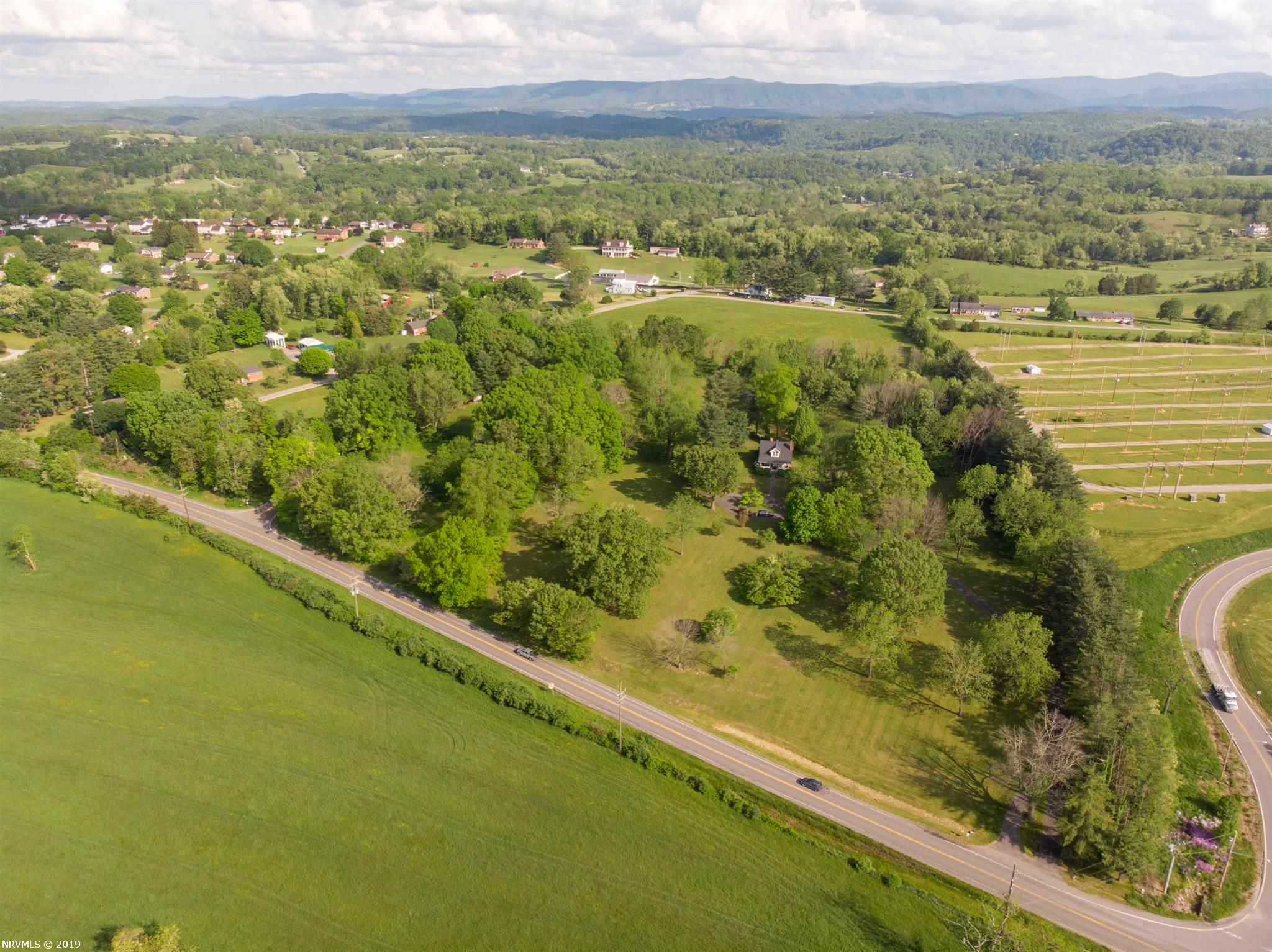 Investors delight of pristine 15.70 acres with state road frontage and left side of property. Paved driveway to home. Zoned residential and would make for a lovely subdivision or may be rezoned industrial.