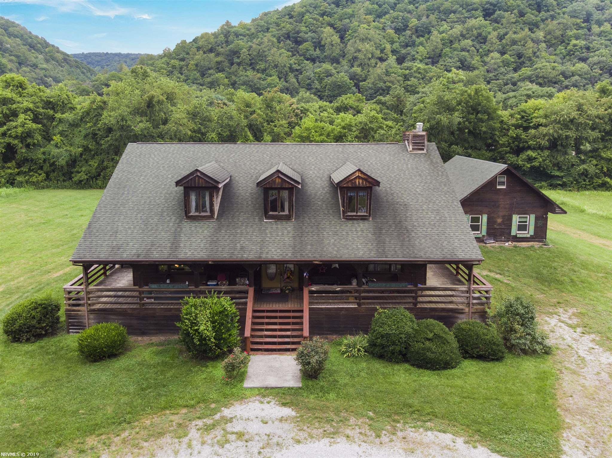 This Beautiful cedar-sided home sits on 7.47 acres in Elliston conveniently located between Christiansburg and Salem.  Rustic log cabin feel, wrap around porch, gas fireplace, vaulted ceilings, exposed beams, large open floor plan, custom cabinets and much more.  Separate guest house with kitchen on site.  Wide open space with barn is perfect for Horse lovers or mini farm enthusiasts.  Great home with lots of space. Needs some TLC, but move in ready. Lot can be divided.  Come see for yourself!