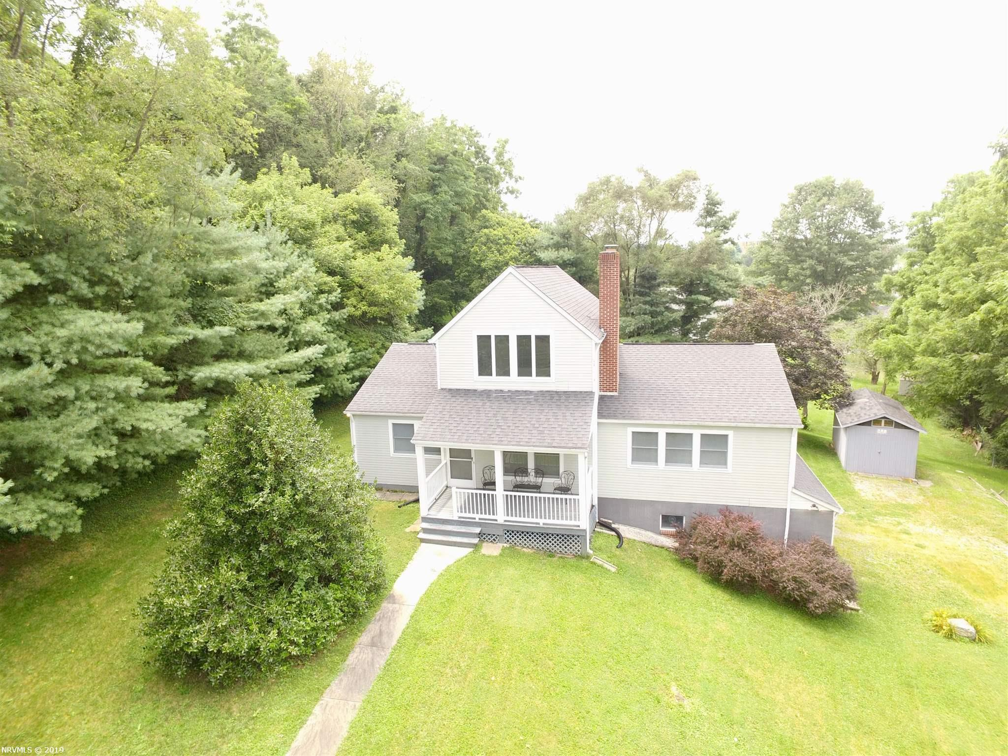 Nice contemporary home offering 3BR, 3 Bath, volume ceilings, beautiful hardwood floors, covered front porch, nice private location, convenient to everything. Full basement offers great storage or shop area.