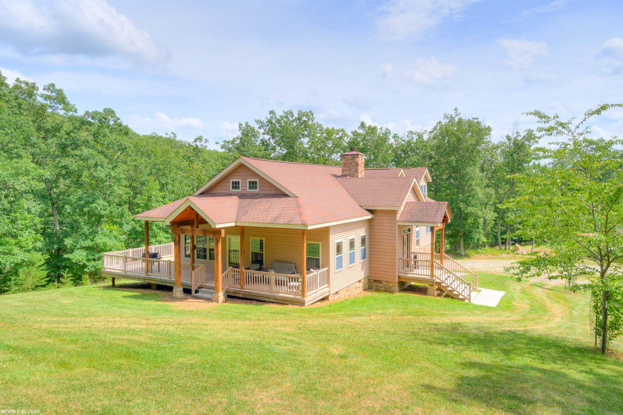 With almost 600 acres, this custom built 3BR, 3.5BA home is located in a very private setting with a pond, cleared yard and beautiful barn, stick-built with Hardy plank, with a massive amount of storage space. Enjoy the open floor plan of this Lodge inspired home, adorned with a stone, wood burning fireplace, huge vaulted ceilings, marble hearth and all three bedrooms on the main level. You will enjoy the luxurious tiled shower in the master bath. The space upstairs is perfect for entertaining including a game room and a gorgeous room perfect for playing cards, a sun room or perfect space for an office with outside access to the deck below.  There is abundant wildlife and fishing that is perfect for the outdoor enthusiast!  Many trails throughout the property with food plots set up for deer and turkey management!  Must see!