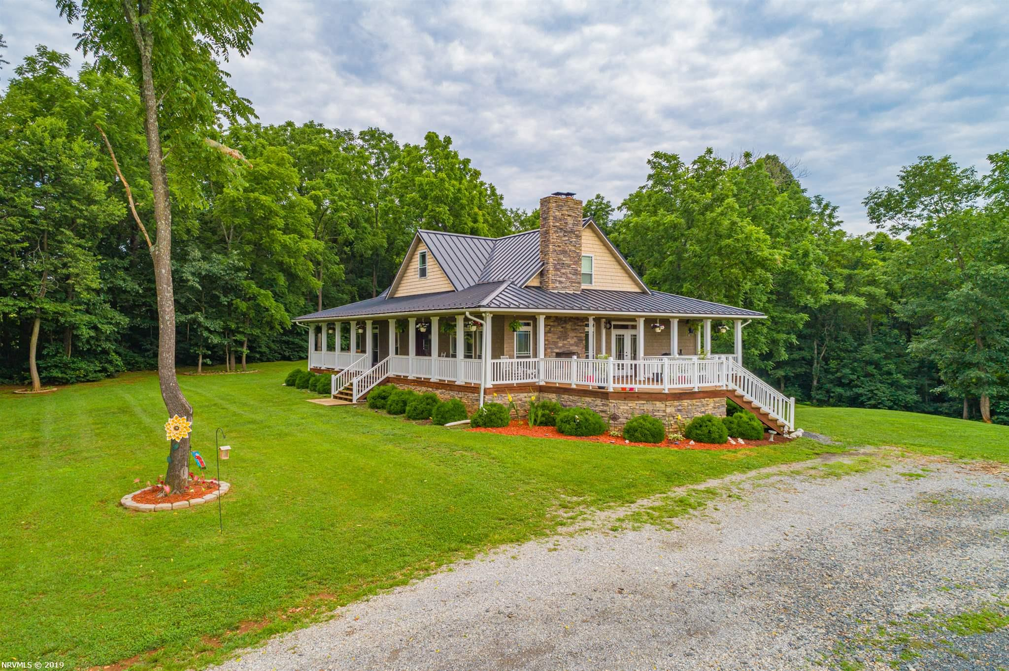 Have the ultimate place that brings you some of the best of what Southwest Virginia has to offer: Mountain and River Views plus New River and New River Trail access! This 38+ acre property boasts long range mountain and river views, 3000 feet of frontage on the New River and access to New Trail. Relax on the wrap around deck with an outdoor fireplace. The craftsman home has an open concept living area which features cathedral ceilings, a top of the line Kitchen including maple cabinets with up lighting, granite counter tops, stainless appliances, stainless farm house sink and prep sink in the island. Two bedrooms on the main level with a third bedroom being a loft open to below with a full bath. Brazilian cherry hardwoods throughout, 10ft ceilings, mission grid windows with transom windows above all windows and door. Ceramic tile floors in the laundry and bath rooms. Three full baths with Jacuzzi tub in the master bath. Full walkout basement and wrap around porch.