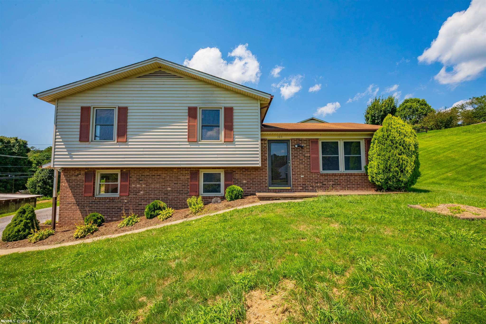 Move-in ready, split level house on 4/10 acre, freshly painted and new carpet. There are only 7 steps between each level and a very nice floor plan. The main level has a living room with beautiful hardwood floors and wood covering the walls for a mountain feel with an electric fireplace. The kitchen is open with eat-in area, pantry, tile on walls, glass sliding doors opening to a 26 x 12 open porch with ceramic tile flooring, all ready for entertaining. The upper level has 3 bedrooms and bathroom, tub/shower has tile walls. The lower level has a bedroom, very large laundry room with a large 8 x 4 closet and the family room could easily be used as a 5th bedroom if needed. The shed and one car carport has electricity. Large yard with privacy fence along one side. The parcel fronts 3 roads so you aren't right next to your neighbor. Great for a family or a mountain getaway in the beautiful Blue Ridge Mountains. The New River and New River Trail close by. Home inspection report on file.