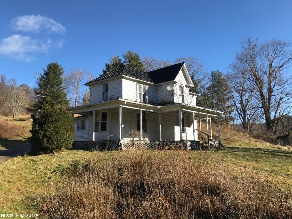This property will be sold AS IS. No Owner Financing. Will not qualify for government financing. Motivated sellers. Floyd County farmhouse on 3.23 acres. Built around 1883 by public record the home needs repair and offers nearly 2,000 sq ft. The ability for up to five bedrooms with two baths. A well was placed on the property around 2007, well and septic information on file. A bold creek flows on the property with several outbuildings. Property sold as is.