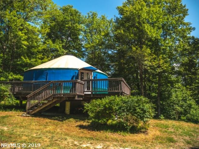 Are you looking to remove yourself from the daily hustle of life? Retreat to a 60 acre mountain paradise in beautiful Floyd VA! Perched on the Blue Ridge Mountain ridge line this secluded & wooded property is absolutely amazing.  Completely wooded of a variety of hardwoods and white pine this 60.17 acres of recreational property comes complete with a 30 ft diameter Yurt.  Over 700 sq ft, completely insulated, beautiful southern yellow pine flooring and an extremely solid, white oak 36'x36' decking system.  Inside a fully furnished kitchen area complete with custom-built counters, cabinets, island with stools. Also a fully enclosed bathroom with toilet, sink and shower.  Wood stove, dining table & 4 chairs, recliners, refrigerator all convey.  The acreage offers abundance of wildlife, two springs and a small creek.  Enjoy the hiking trails along the ridge peak. Potential amazing view exist with prime building spot should you desire. Excellent location to Blacksburg, Floyd and Roanoke!