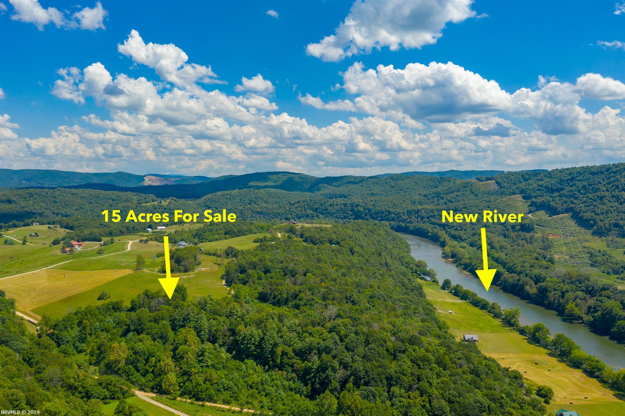 Nudged right against the New River is this remarkable 15 acre property. The land is both open and wooded, so you have a variety of ways to build your dream home. Access to the river is deeded via the River Hills community area, making this an exclusive point of the New River that you'll feel you can call your own. With unparalleled views and located only a short drive from great shopping and amenities, this land is versatile and ready for your creativity. Set up an appointment to look at it today!