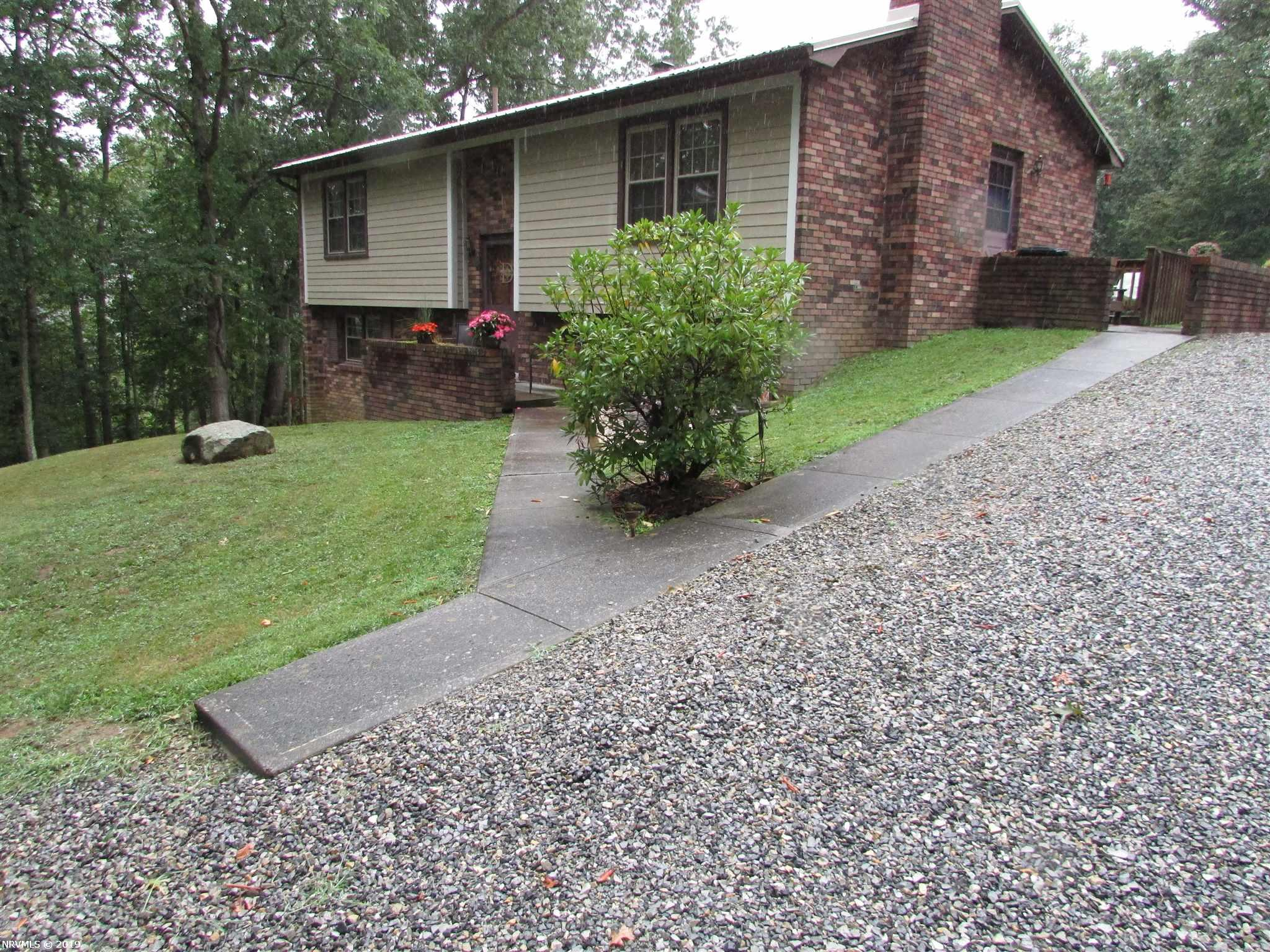 HUNTERS PARADISE; 114 +or - acres of wooded mountain land. 4 WHEELER TRAIL TO TOP OF THE MT. BEAR,DEER TURKEY AND SMALL GAME PLENTIFUL. LARGE TREE STAND IN PLACE AND READY FOR HUNTING SEASON. Plus a beautiful 3/4 bedroom split foyer.  Kitchen with laminate flooring, stove, refrigerator(new), microwave, eat in kitchen, dining room off kitchen, 12x13  living room with fireplace /wood burning stove, full bath with shower/tub, two bedrooms on upper level with carpet and paneling. Lower level has a bedroom with tile floors, paneling, bath with tile floor, shower only no tub, office or bedroom tile floors, large 22x15 den with fireplace with wood stove installed.  Utility room with washer/dryer, furnace area and stove or workshop. 24 x 40 Garage/workshop, pull down stairs to floored attic for extra storage. heated by a oil/wood stove,. 14 x16 storage building out back of the garage.  VERY PRIVATE LOCATION ONLY 1.2 MILES FROM RT.100.