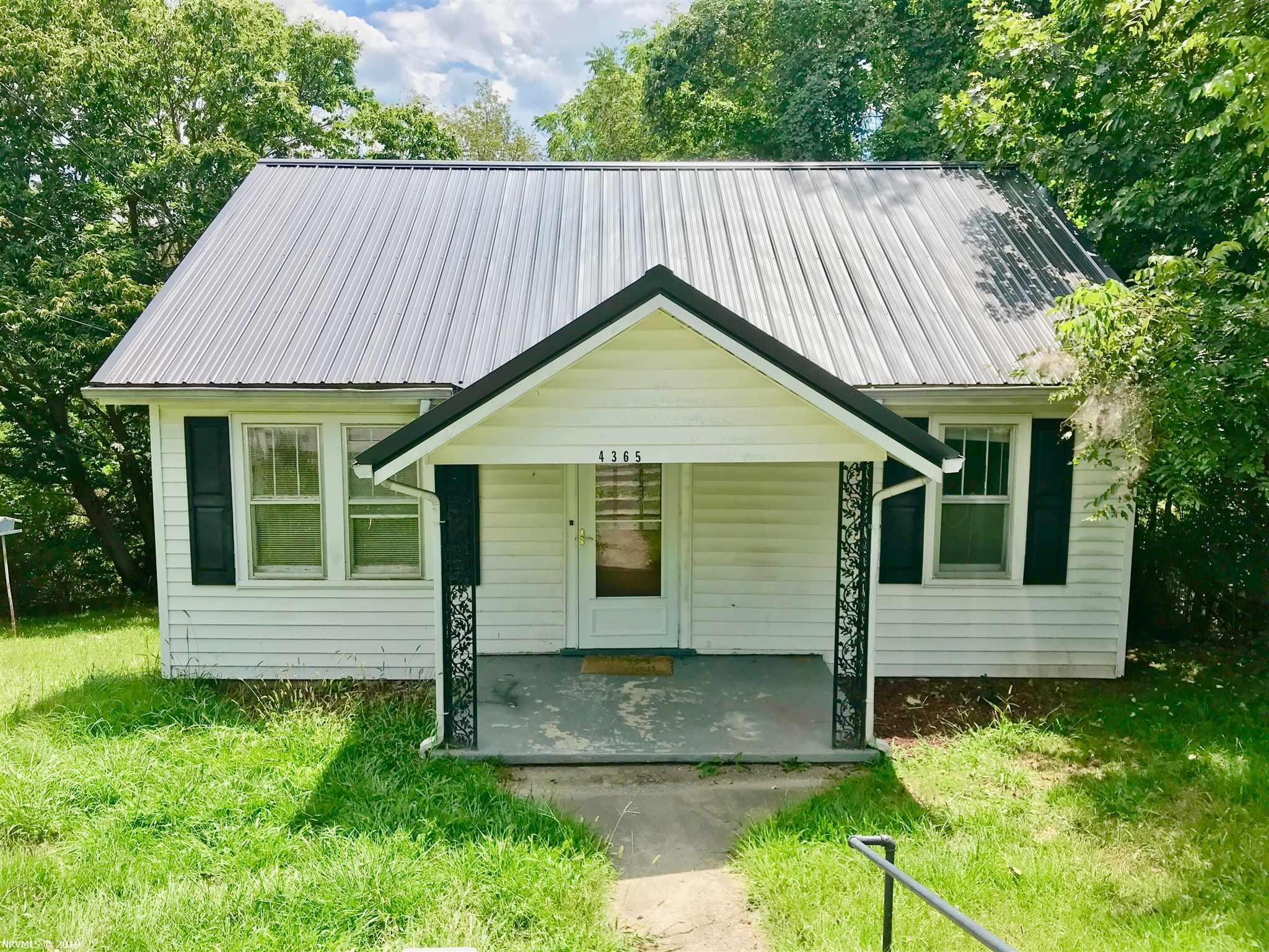 Excellent opportunity to make improvements for an investor. Bungalow style cottage in Pulaski VA with hardwood floors, ceramic tiled bath, ceiling fans, storm doors and a storage shed. Spacious kitchen offers an appliance package, plenty of cabinet and counter space, plus a pantry. Two main level bedrooms and a full bath including a spa tub. The basement has outside access and laundry area.  Situated on a lot with mature trees and a deck to enjoy the views. Sold as-is where is!