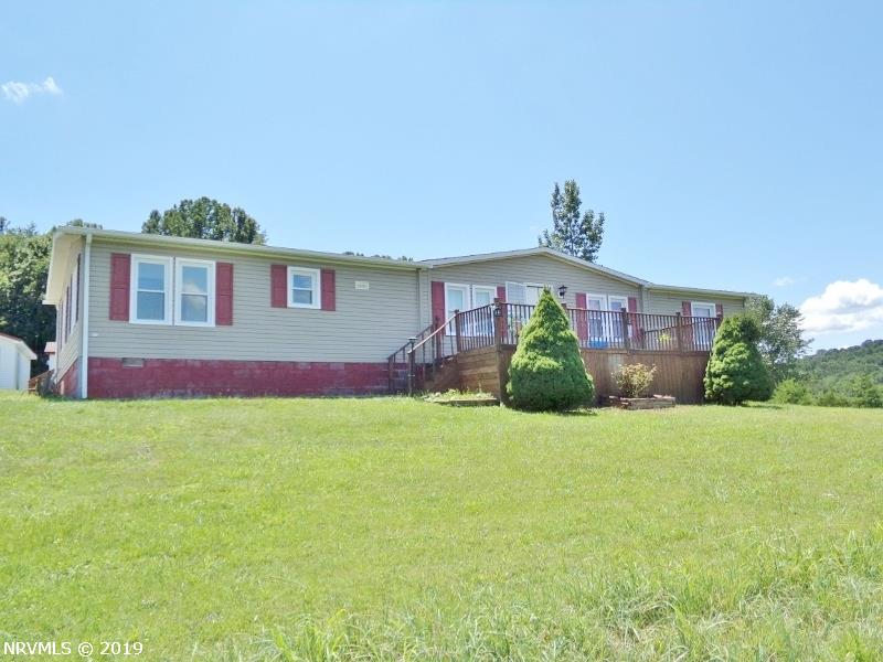 Beautiful view from this spacious Doublewide on 6.56 acres in the Bear Springs area of Giles Co. Updates! Heat pump only 4+/- yrs old. Insulated windows. Laminate flooring. Great Kitchen w/pantry & lots of cabinet space! Det Double Garage. Relax on the two large decks.