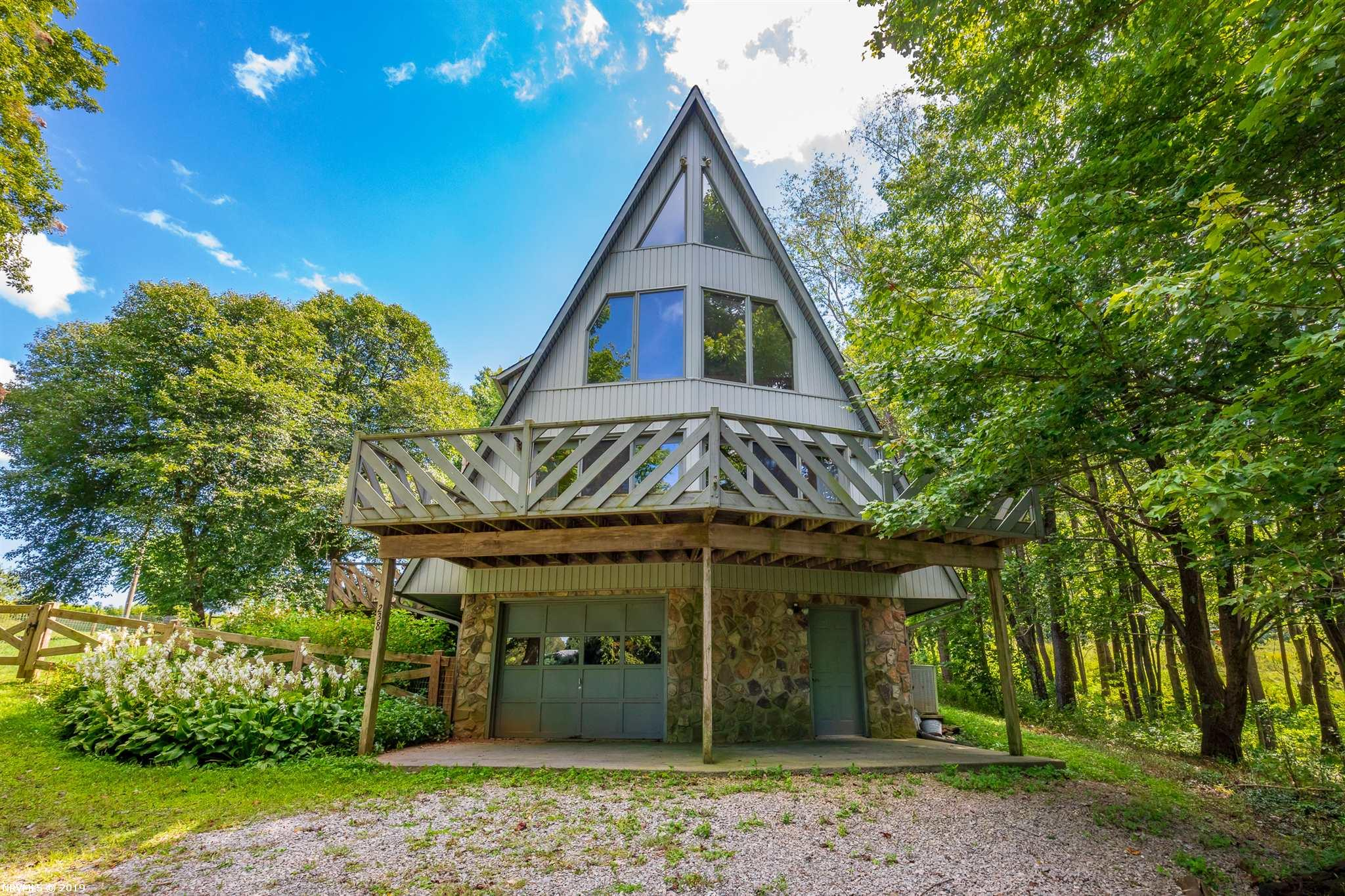 This charming A-Frame house could be your own private paradise! This picturesque property has both beautiful woods and sloping pastures, offering gorgeous views no matter where you are. With a fenced in yard and a gazebo located right in the heart of the property, you won't want to go inside! The house is full of character as well as functionality. With a full finished basement and game room, it offers amenities not often seen in this area. While it feels like a secluded mountain dreamscape, you are actually only five minutes from Rural Retreat and exit 60 on I-81, with quick access to Wytheville, Abingdon, Bristol, and more. Don't miss out on this amazing home!