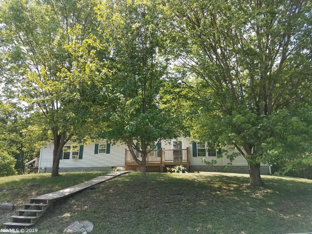 Very nice single floor home in Montgomery county.  Rural location between Christiansburg and Blacksburg but just minutes from all amenities.  Within walking distance to the Huckleberry Trail.  Extra large great room with fireplace.  Split floor plan for the bedrooms.  The extra large master bedroom has a huge walk in closet.  There is a new roof on the home.  The land is fenced and would make a perfect mini farm.  Large storage building to stow away all the extras.  Suitable for horses.  Beautiful views.  Enjoy the privacy of the location and expand your outdoor living space on the large patio.  The home is on a permanent foundatin.
